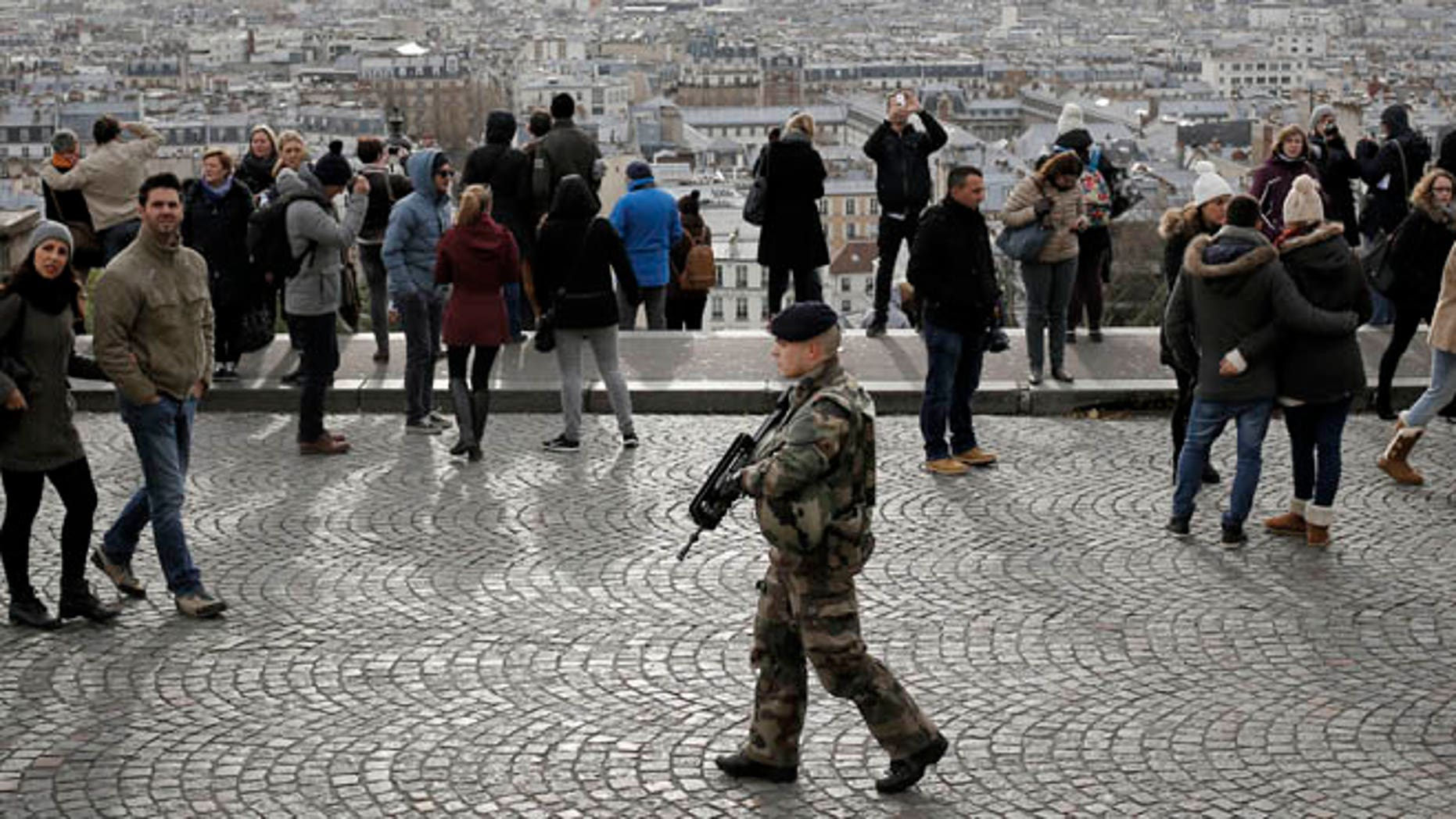 Nov. 21, 2015: A soldier patrols outside the Sacre Coeur basilica in Montmartre  Paris. Security has been on high alert in the  French capital, after the attacks in Paris on Nov. 13, which killed 130 people.