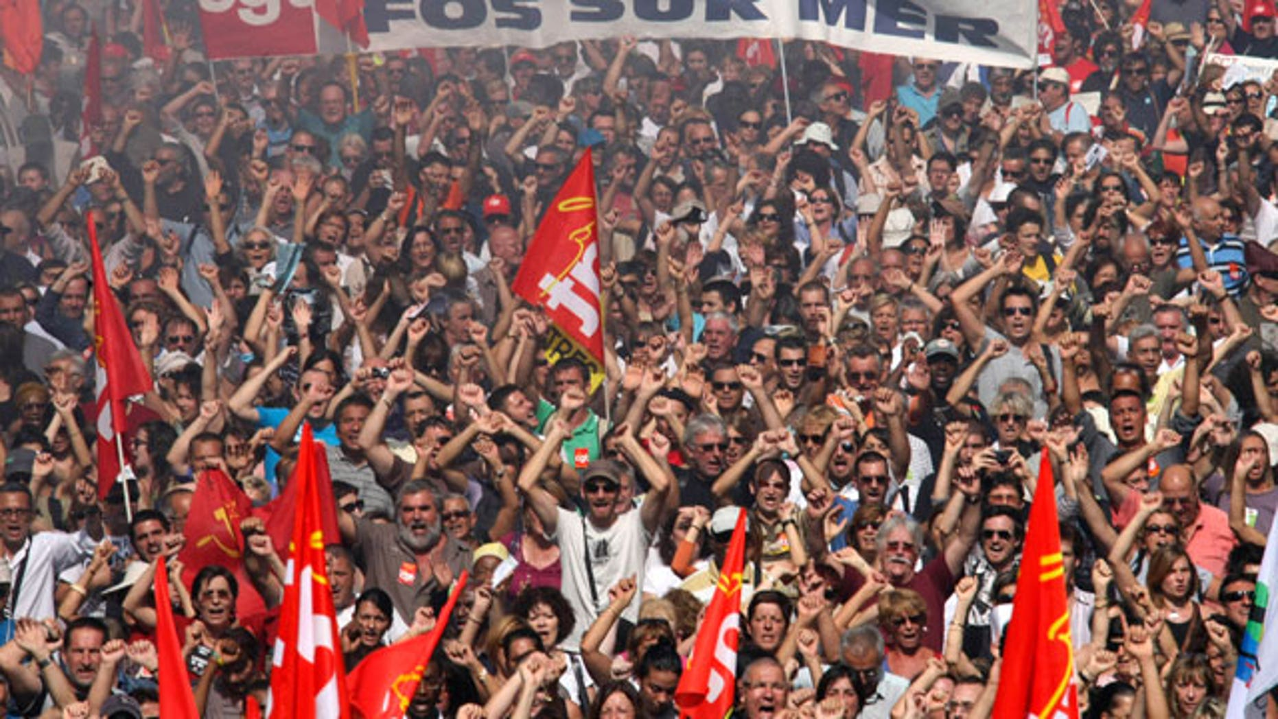 People march during a protest, in Marseille, southern France, Thursday, Sept. 23, 2010. French commuters squeezed onto limited trains or fought for rare parking spots Thursday as a second round of strikes against President Nicolas Sarkozy's plan to raise the retirement age to 62 hobbled trains, planes and schools across the country.