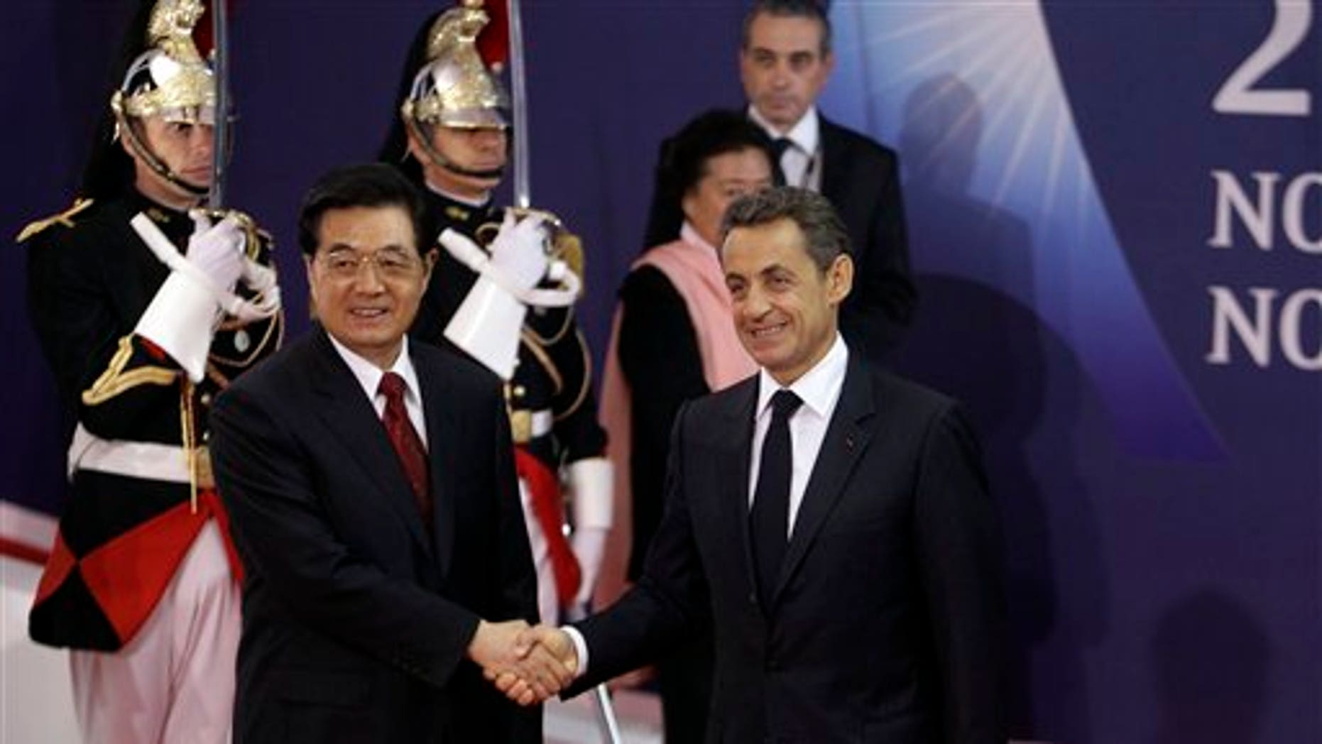 Nov. 2, 2011: French President Nicolas Sarkozy, right, shakes hands with China's President Hu Jintao during arrivals for the G20 summit in Cannes, France.