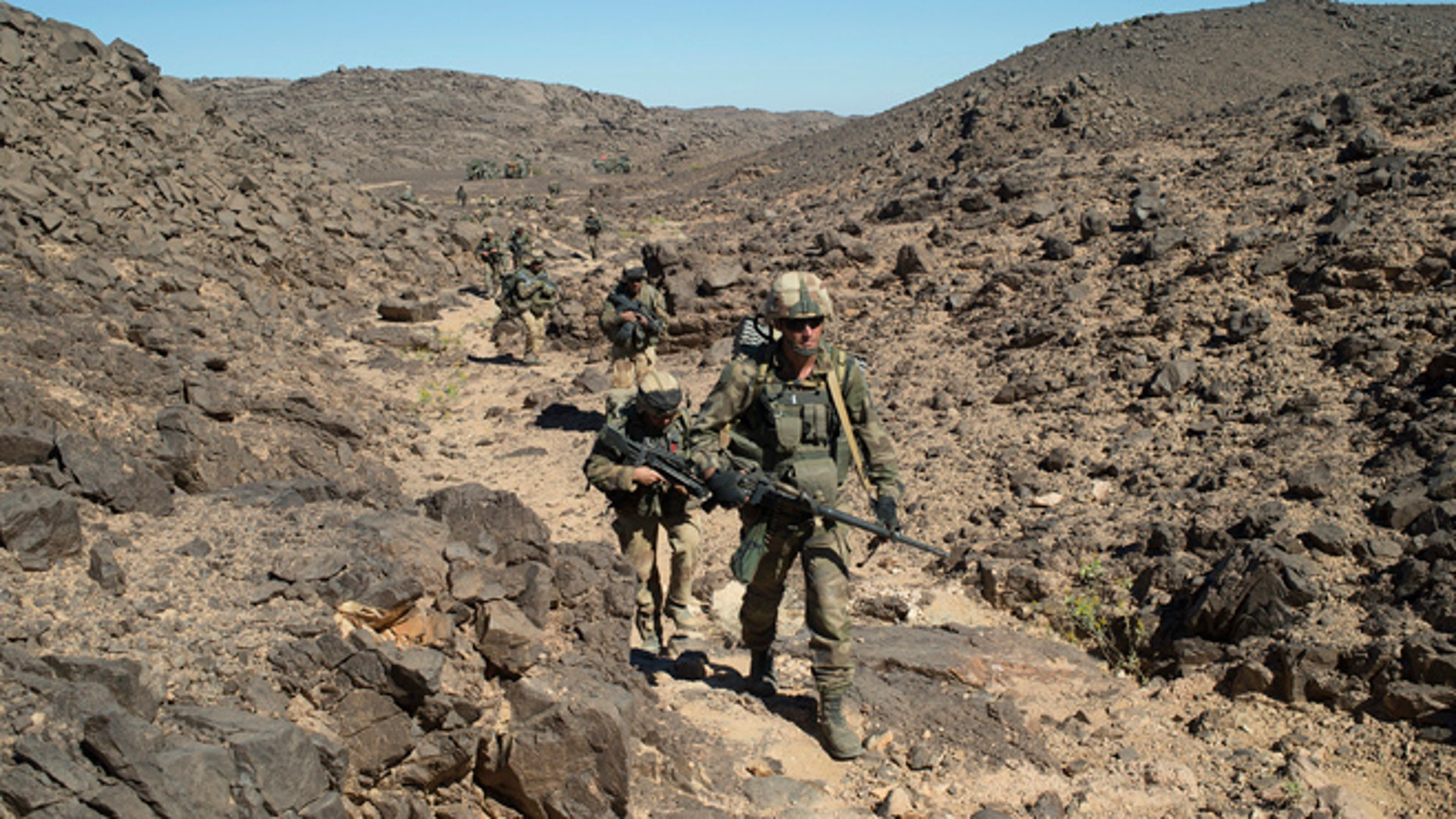 March 8, 2013: In this photo taken by the French Army Communications Audiovisual office (ECPAD) shows French soldiers patrolling in the Mettatai region in northern Mali.