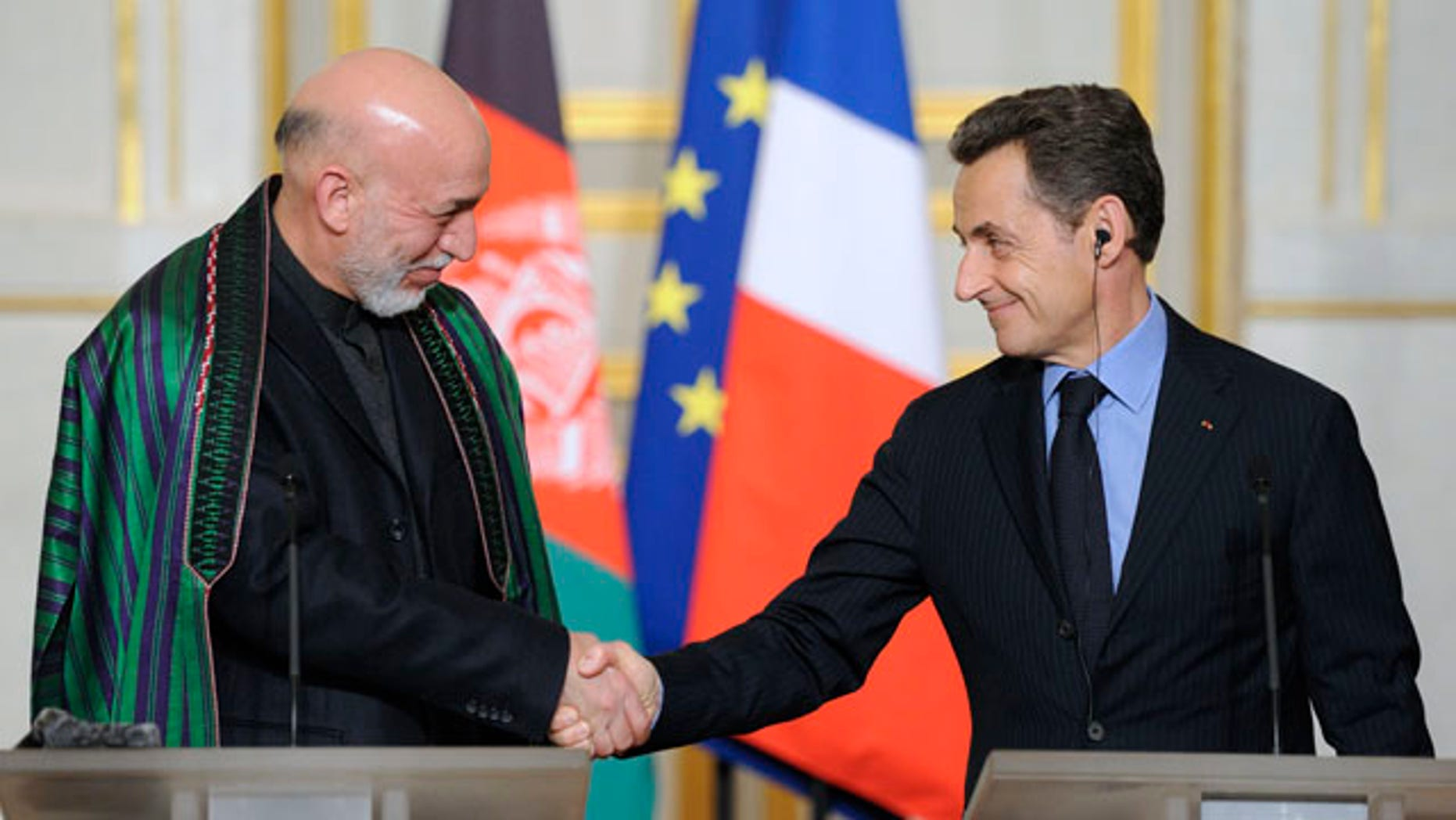 Jan. 27, 2012: Afghan president Hamid Karzai, left, shakes hands with French President Nicolas Sarkozy, right, following a news conference at the Elysee palace in Paris.