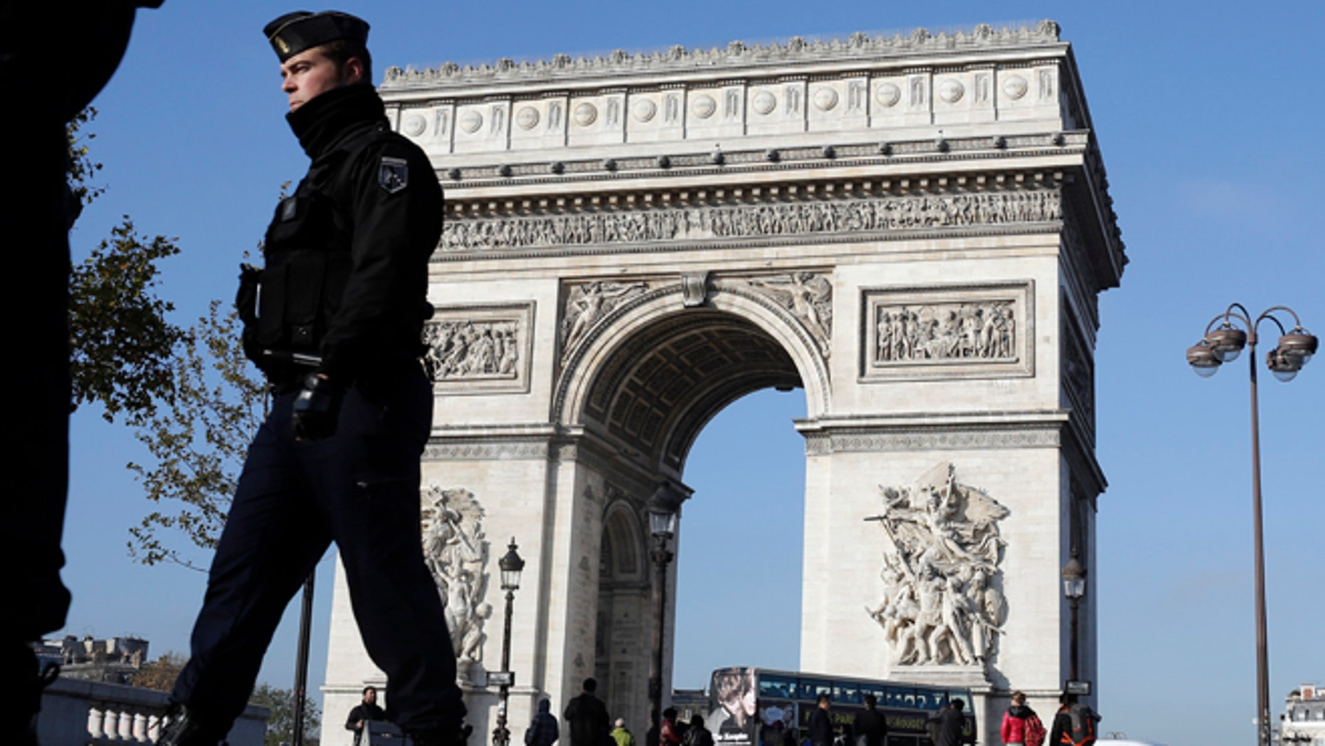 Nov. 23, 2015: A French gendarme officer patrols in front of the Arc de Triomphe, on the Champs Elysees, in Paris.