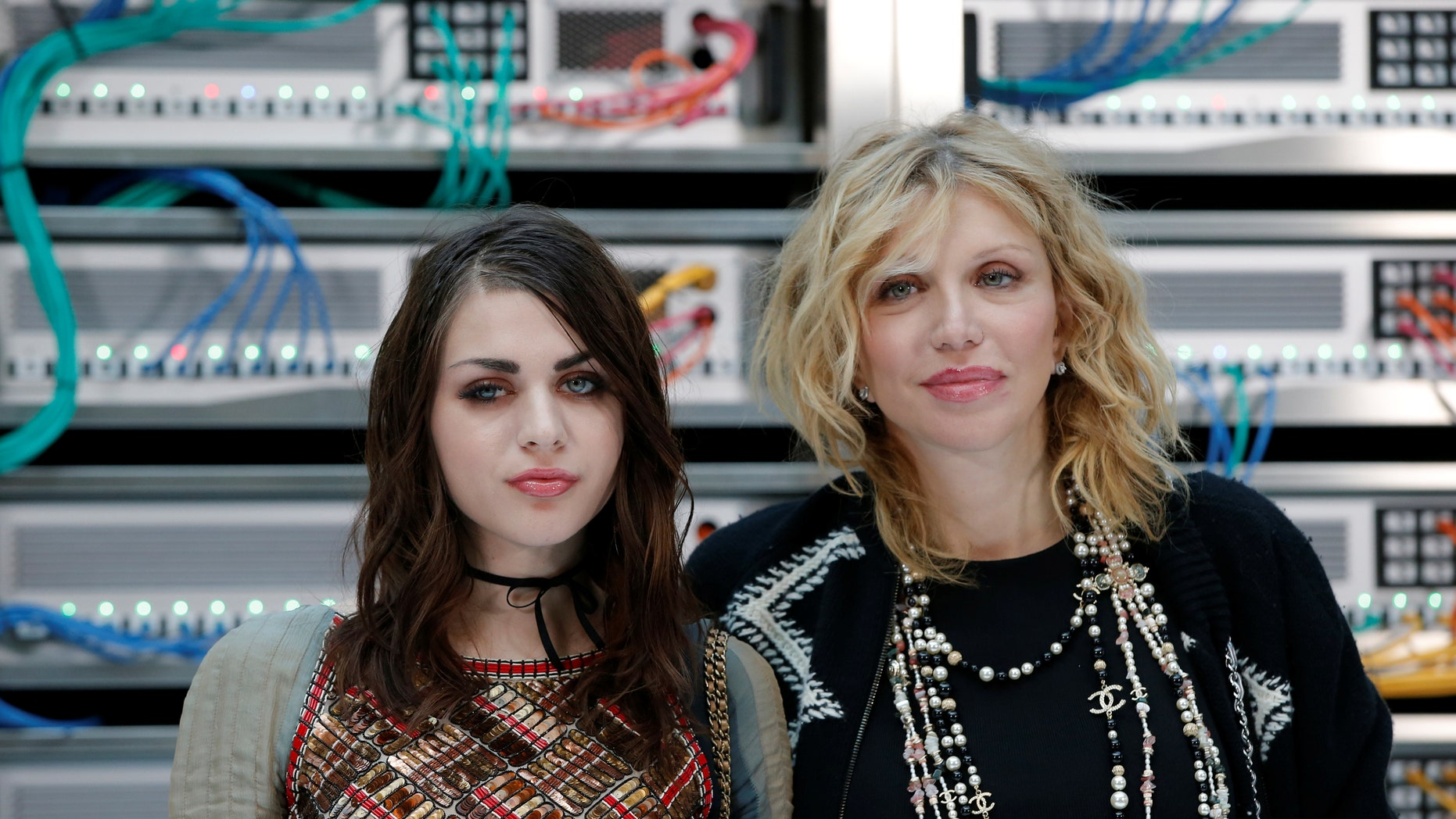 Courtney Love, right, is accused of hiring men to kill Frances Bean Cobain's ex-husband in June 2016.
