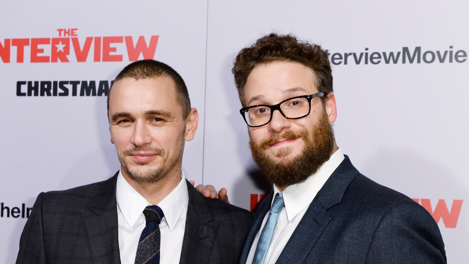 """December 11, 2014. Cast members James Franco (L) and Seth Rogen pose during premiere of the film """"The Interview"""" in Los Angeles, California."""