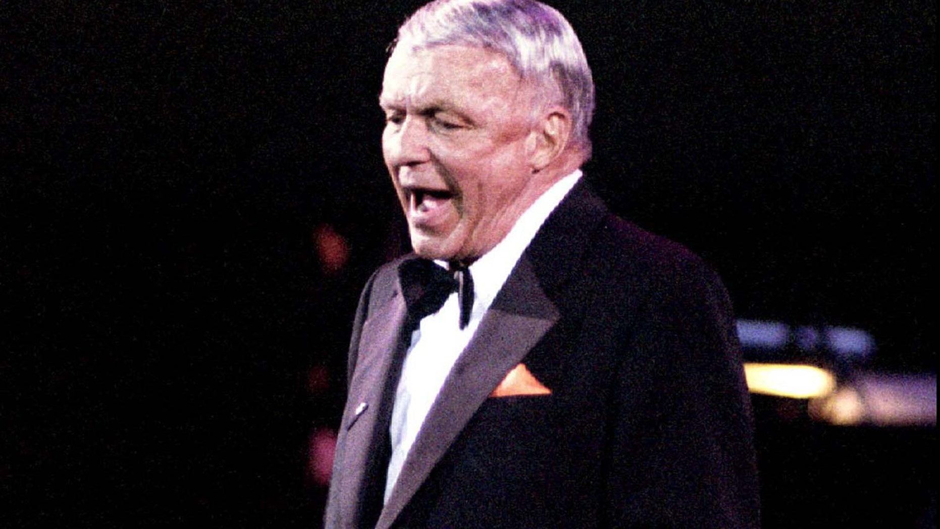 Frank Sinatra belts out a song during a concert in Manila in this file photo of June 28, 1994.