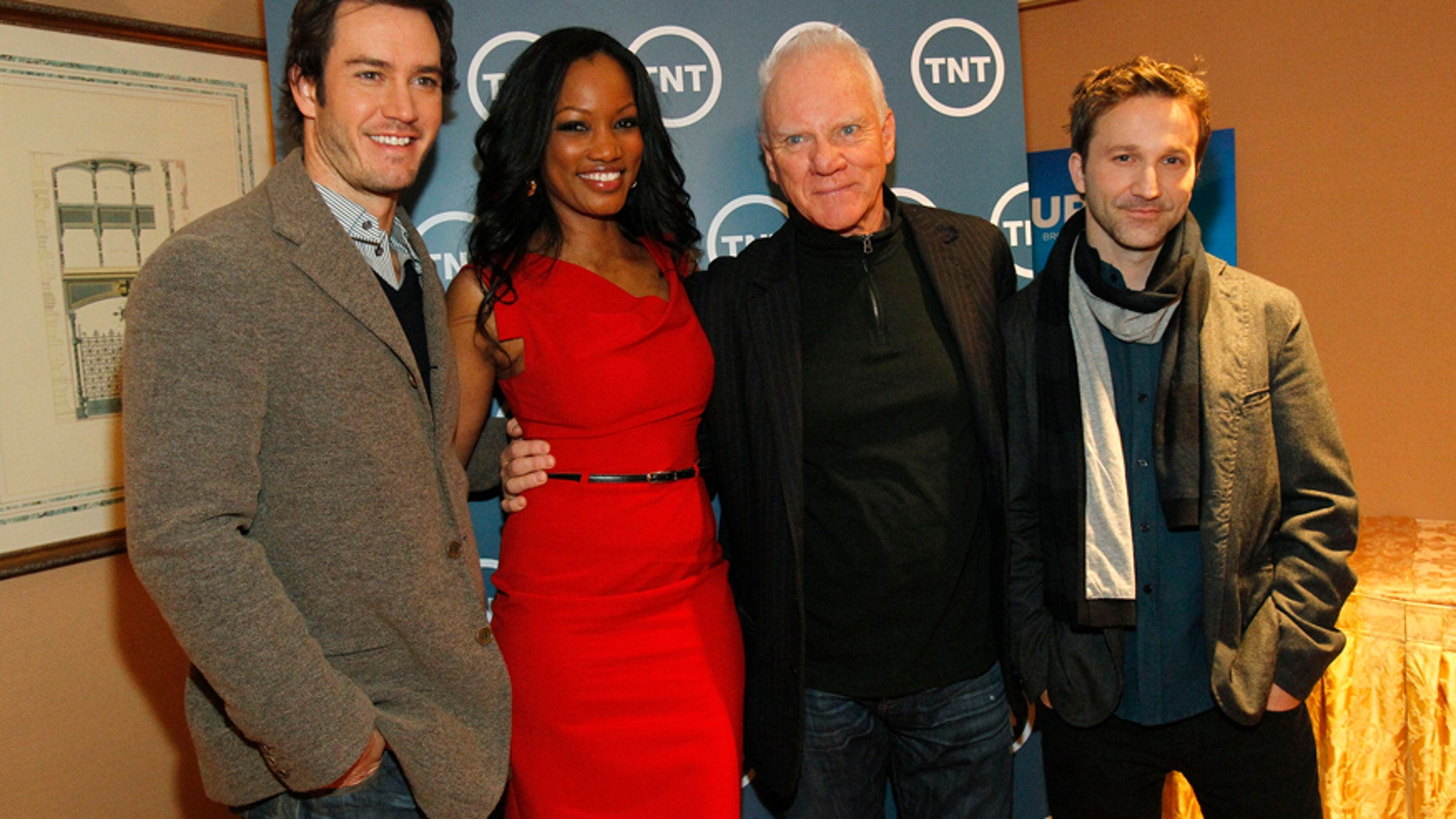 """Cast members (from L-R) Mark-Paul Gosselaar, Garcelle Beauvais, Malcolm McDowell and Breckin Meyer from the television series """"Franklin & Bash"""" pose during the Turner Broadcasting Television Critics Association winter press tour in Pasadena, California January 6, 2011."""