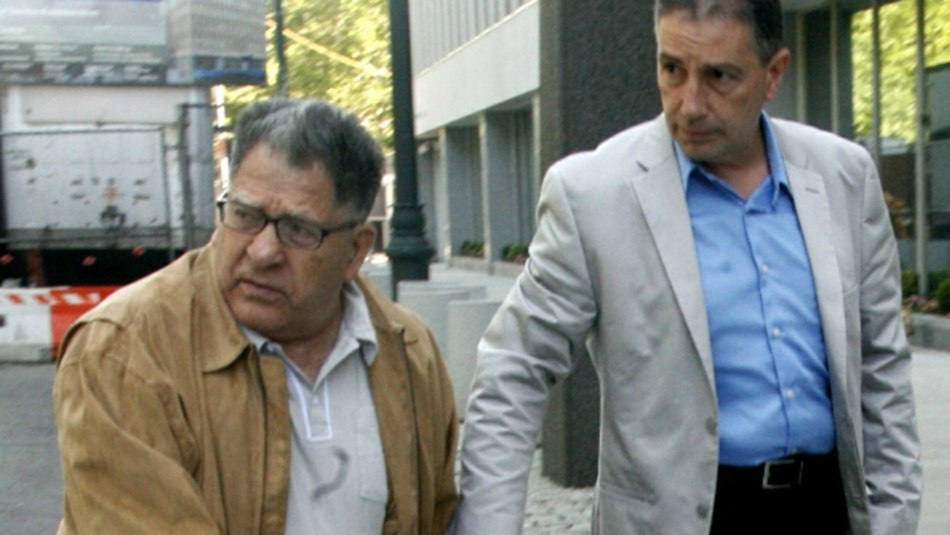 """June 15, 2010: John """"Sonny"""" Franzese, left, arrives at federal court in Brooklyn, New York. To the dismay of supporters who insist the frail 93-year-old is a decrepit shadow of his former self, the government has asked a judge in federal court in Brooklyn to sentence him on Friday to 12 years or more in prison. (AP)"""