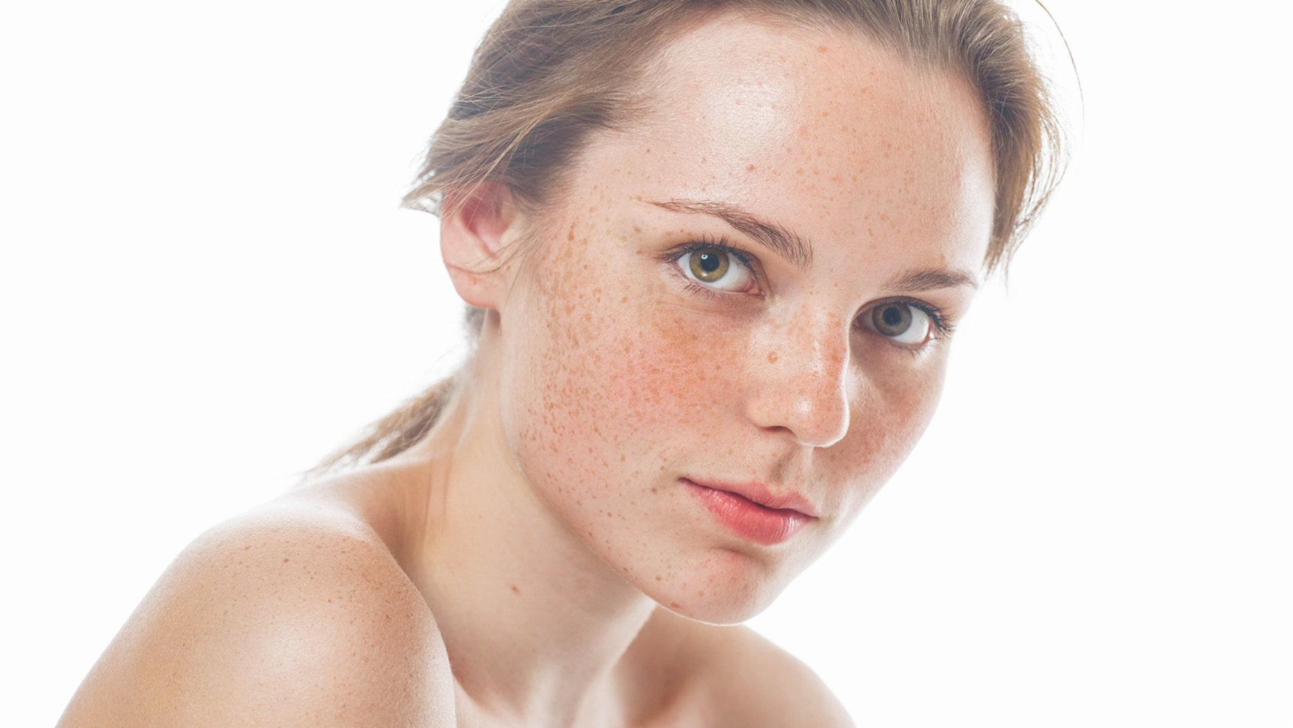Woman studio beauty portrait happy healthy skin  with long hair