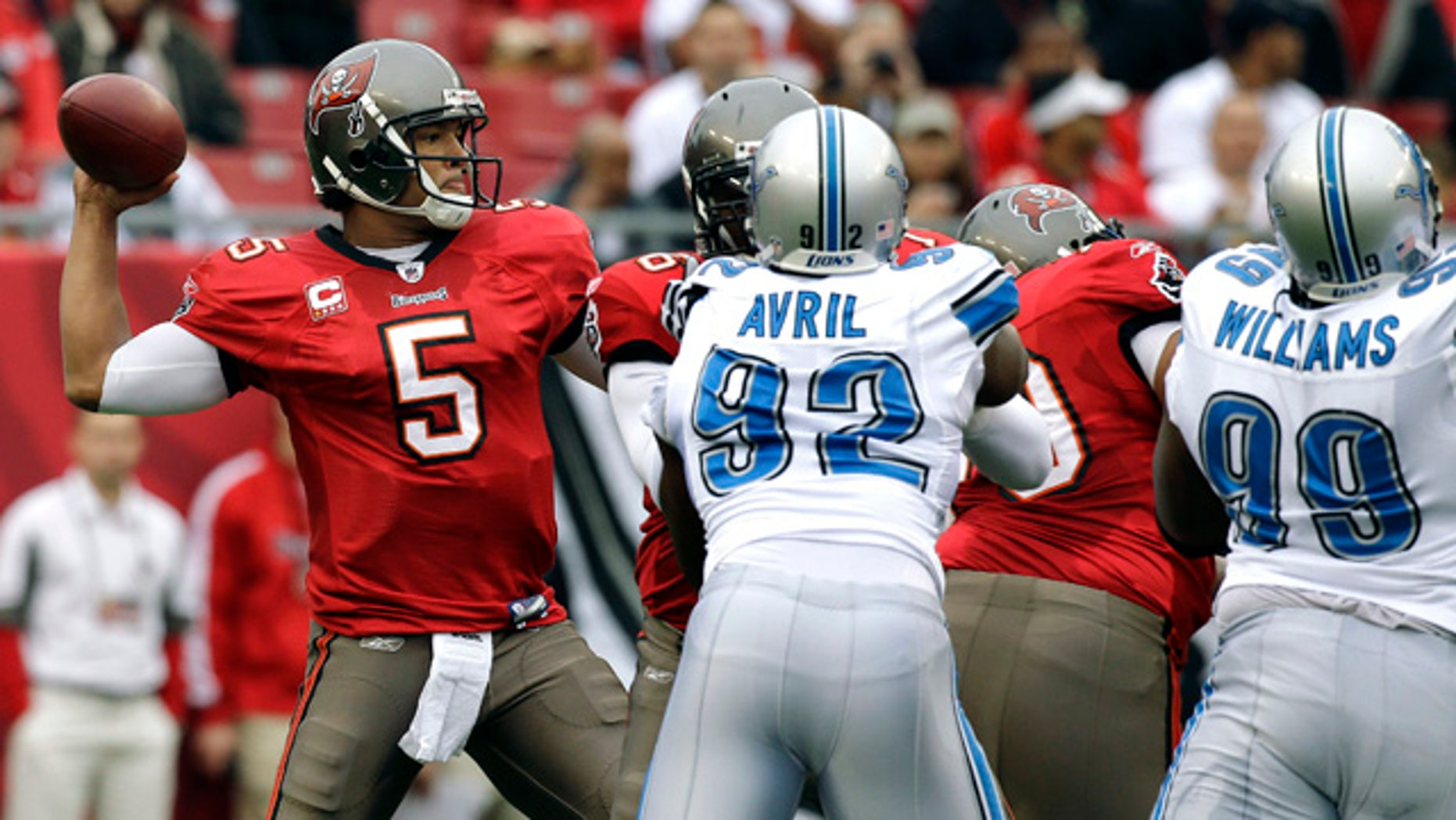 Dec. 19: Tampa Bay Buccaneers quarterback Josh Freeman (5) throws as Detroit Lions defensive end Cliff Avril (92) and defensive tackle Corey Williams (99) pursue during the first quarter of an NFL football game in Tampa, Fla. (AP)