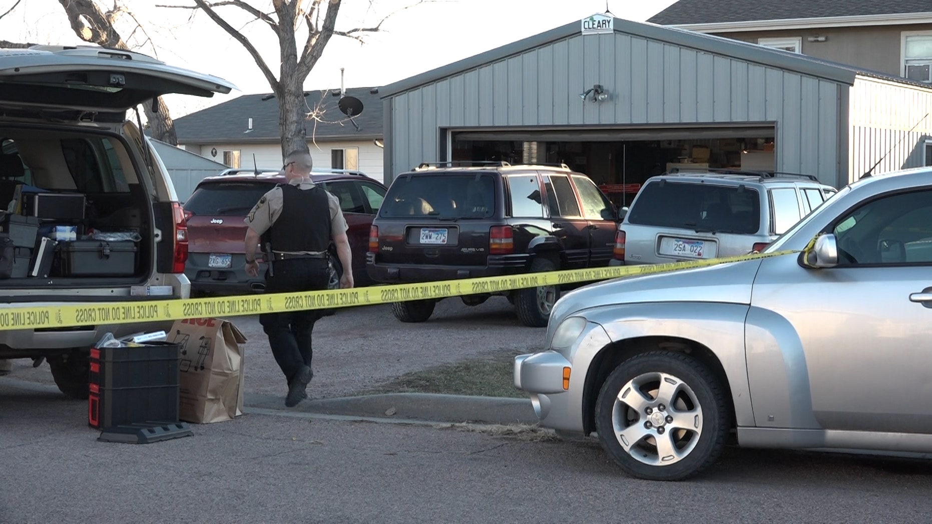 Law enforcement in South Dakota investigate the scene where a woman's body was found in a freezer.