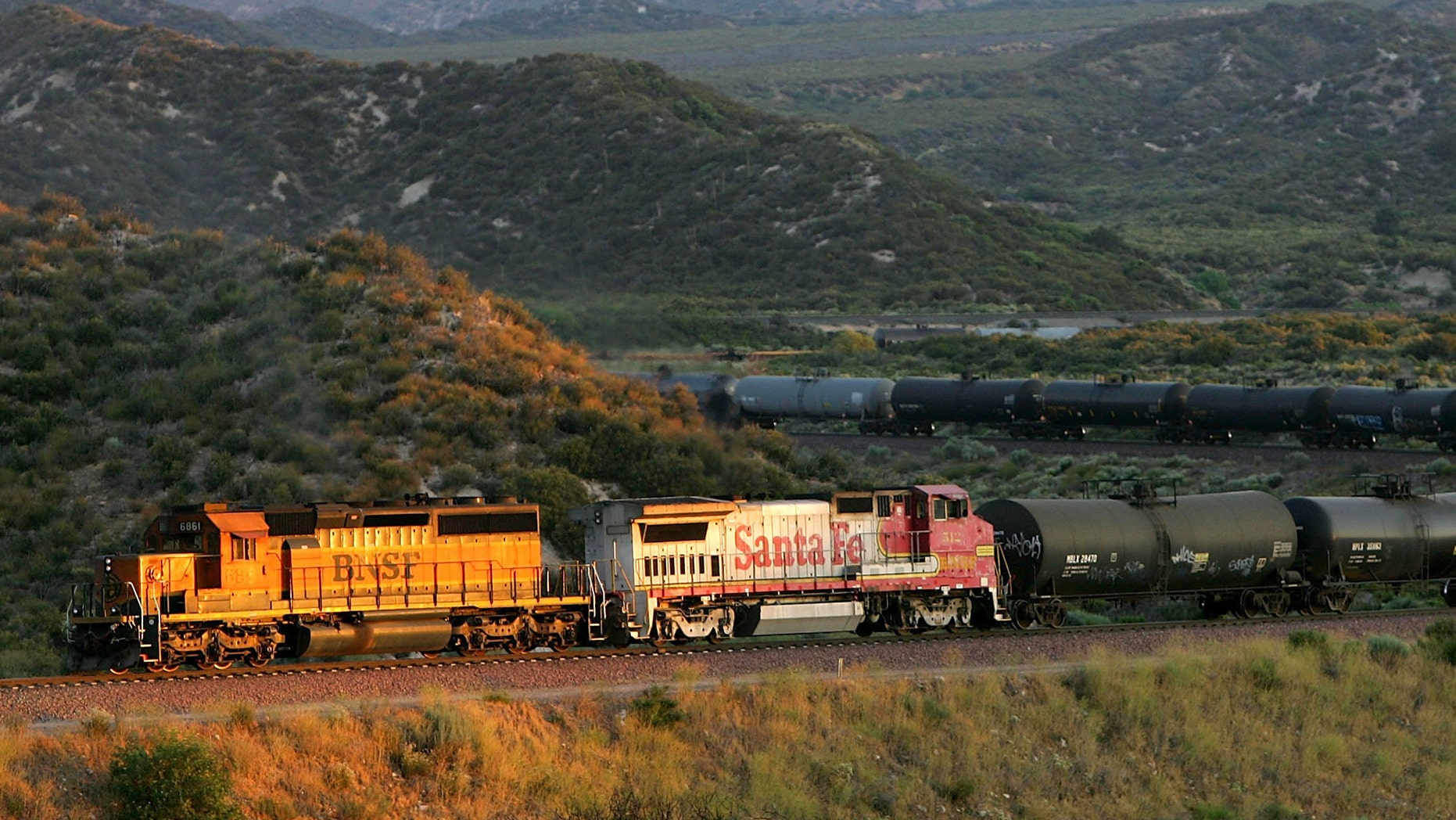 SAN BERNARDINO, CA - JULY 01: A freight train moves through Cajon Canyon near the San Andreas Rift Zone on July 1, 2006 near San Bernardino, California. The railway which crosses the San Andreas Fault and passes through the Cajon Pass is one of the busiest in the nation, transporting goods to and from the ports of Los Angeles and Long Beach. Scientists have warned that the southern end of the 800-mile-long San Andreas fault north and east of Los Angeles has built up immense pressure and could produce a massive earthquake at any time. Such a quake could produce a sudden lateral movement of 23 to 32 feet which would be would be among the largest ever recorded. (Photo by David McNew/Getty Images)