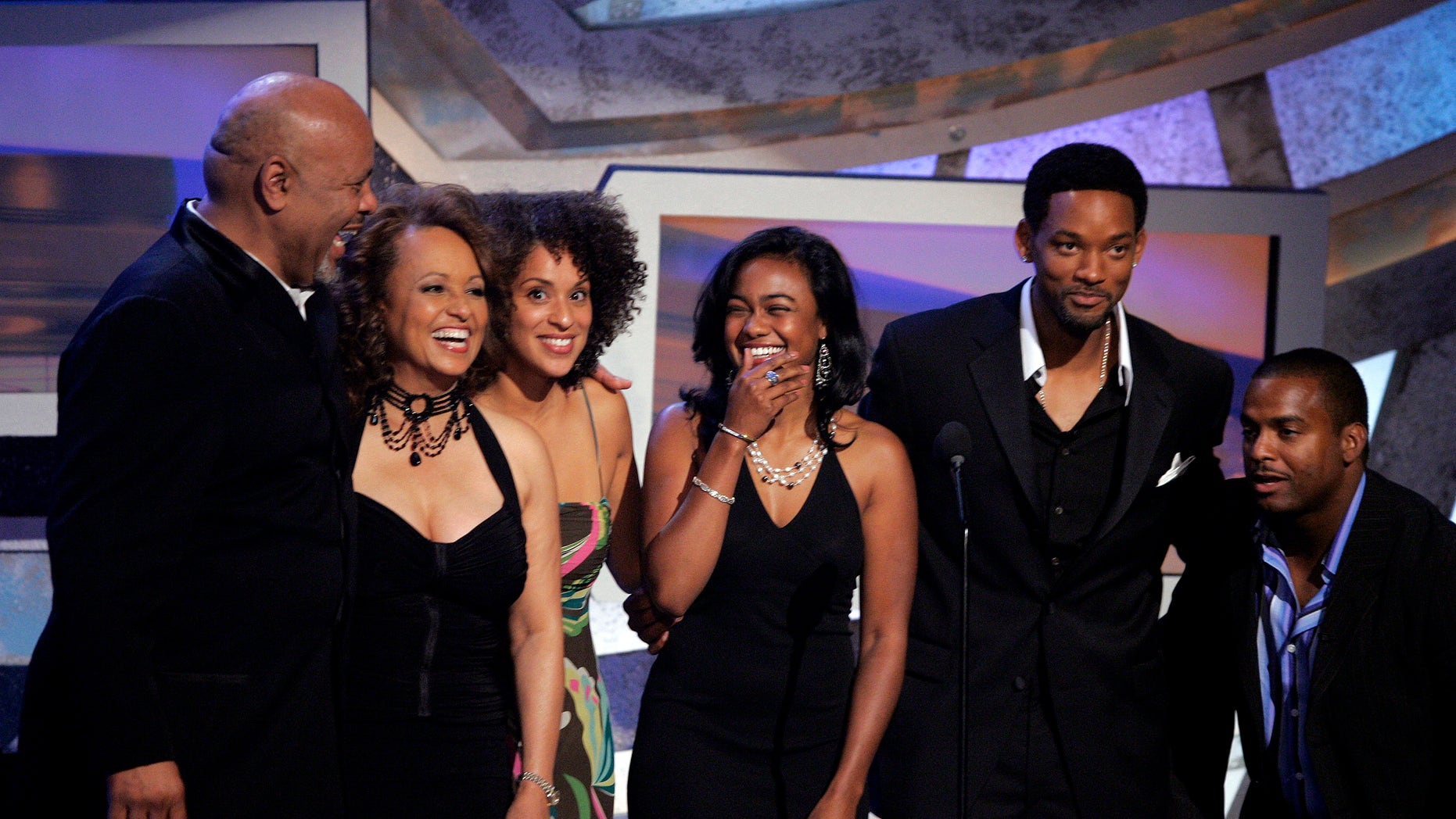 The cast of the television series 'The Fresh Prince of Bel-Air' (L-R) James Avery, Daphne Maxwell Reid, Karyn Parsons, Tatyana Ali, Will Smith and Alfonso Ribeiro reunite as they help to present an award at the 5th annual 2005 BET Awards at the Kodak Theatre in Hollywood, California June 28, 2005. REUTERS/Robert Galbraith  FSP/TW - RTRFTN5