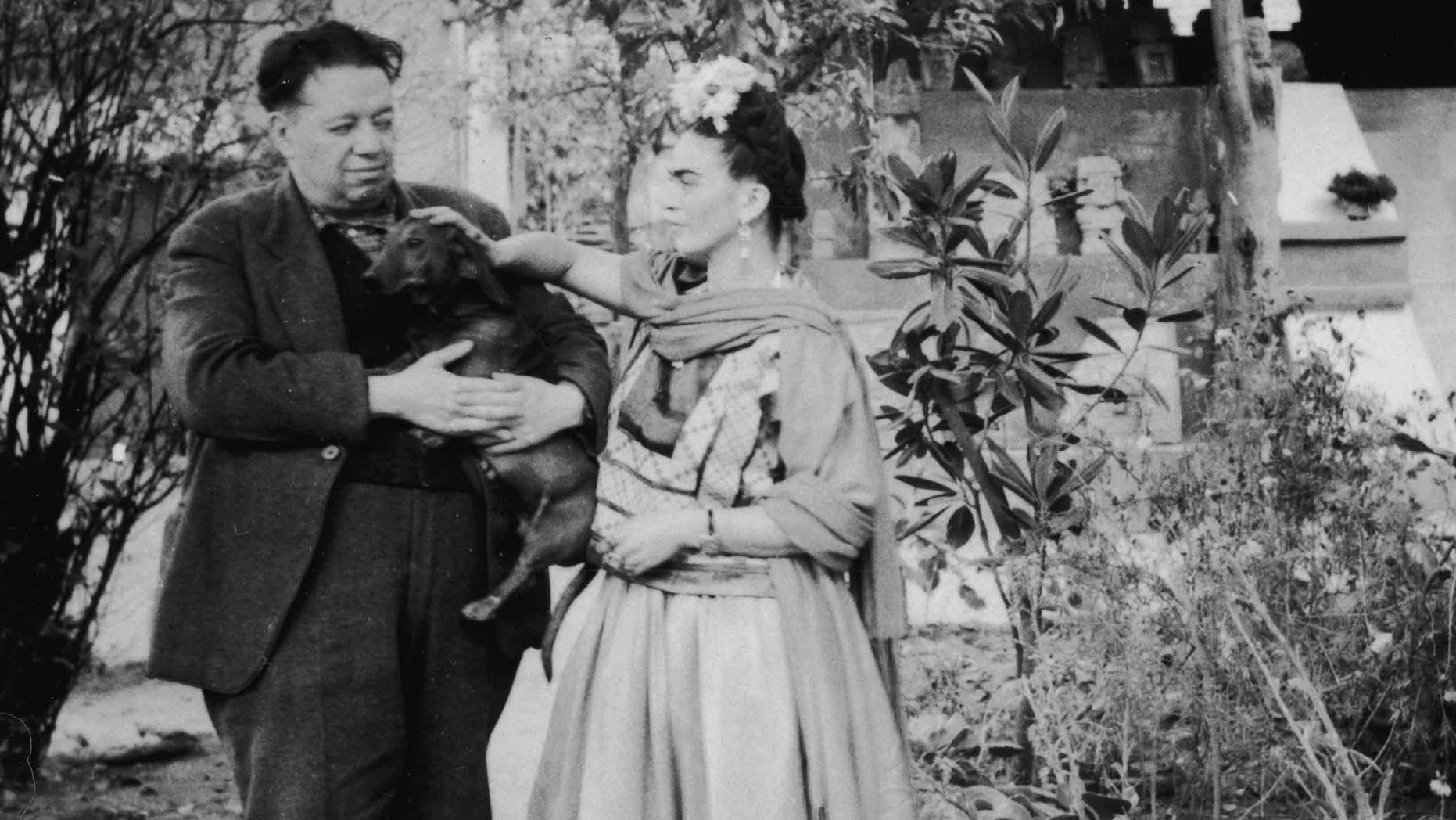 Frida Kahlo and Diego Rivera with a pet dog in Mexico City, Mexico, 1940s.