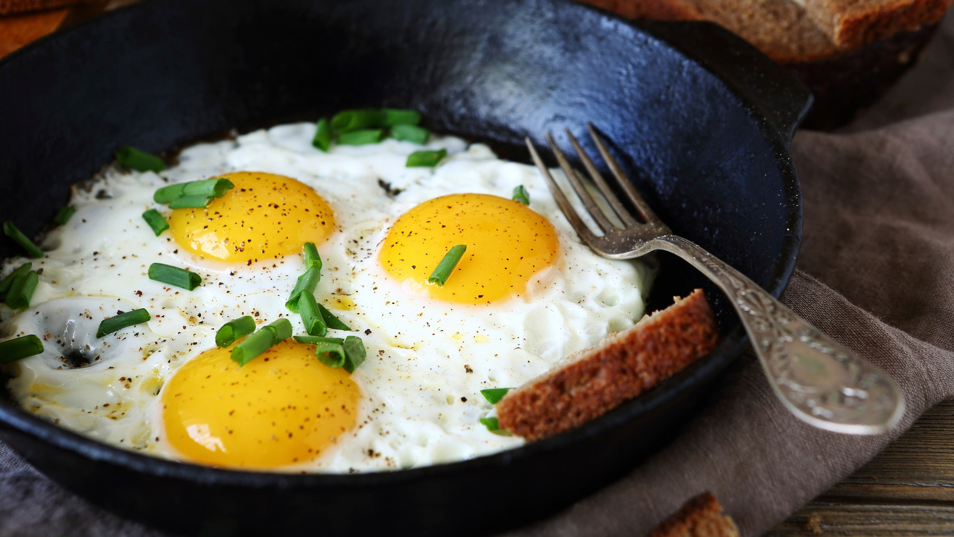 Hot fried eggs in a pan, close up