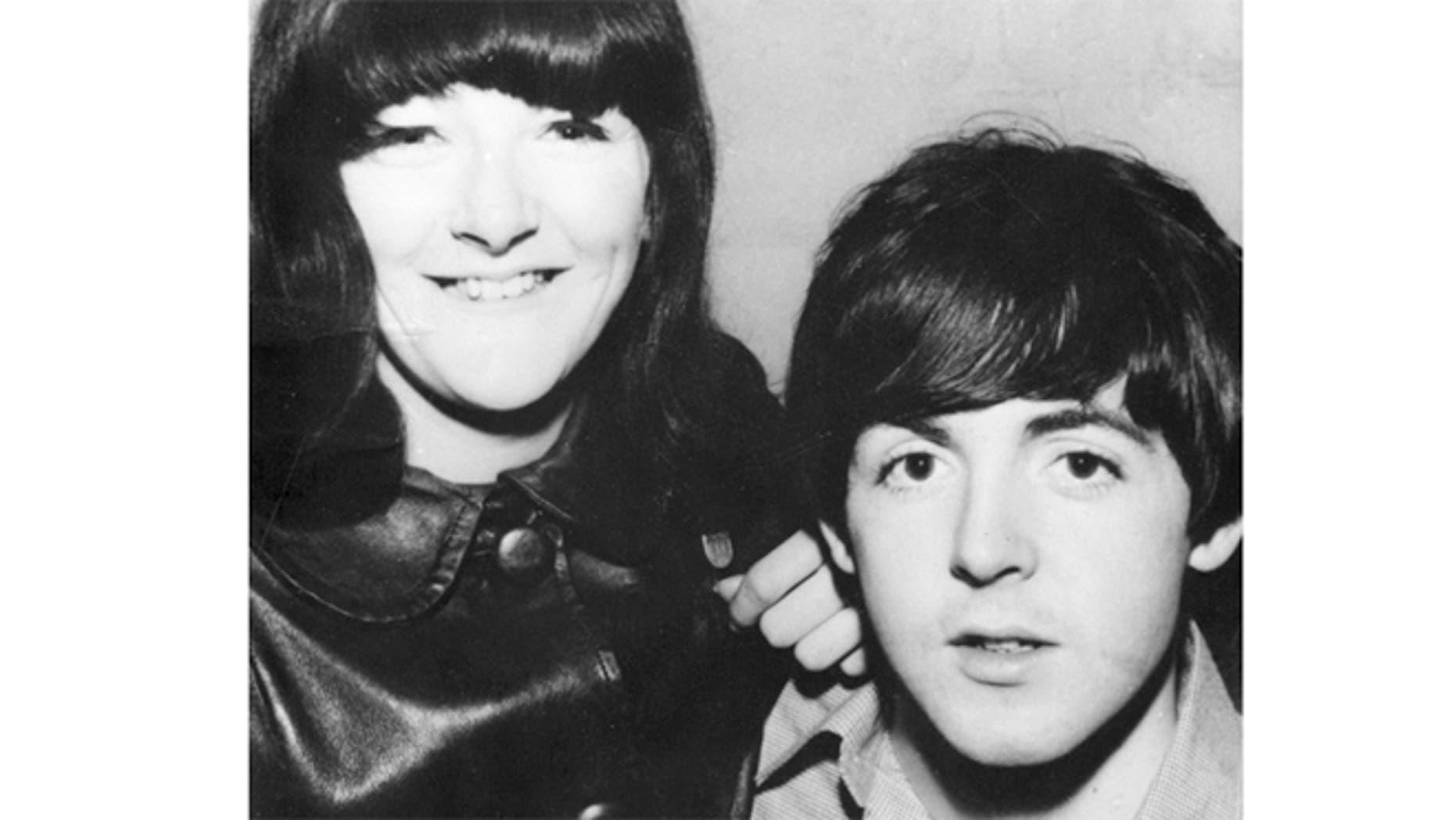 Freda Kelly is seen posing with Paul McCartney.
