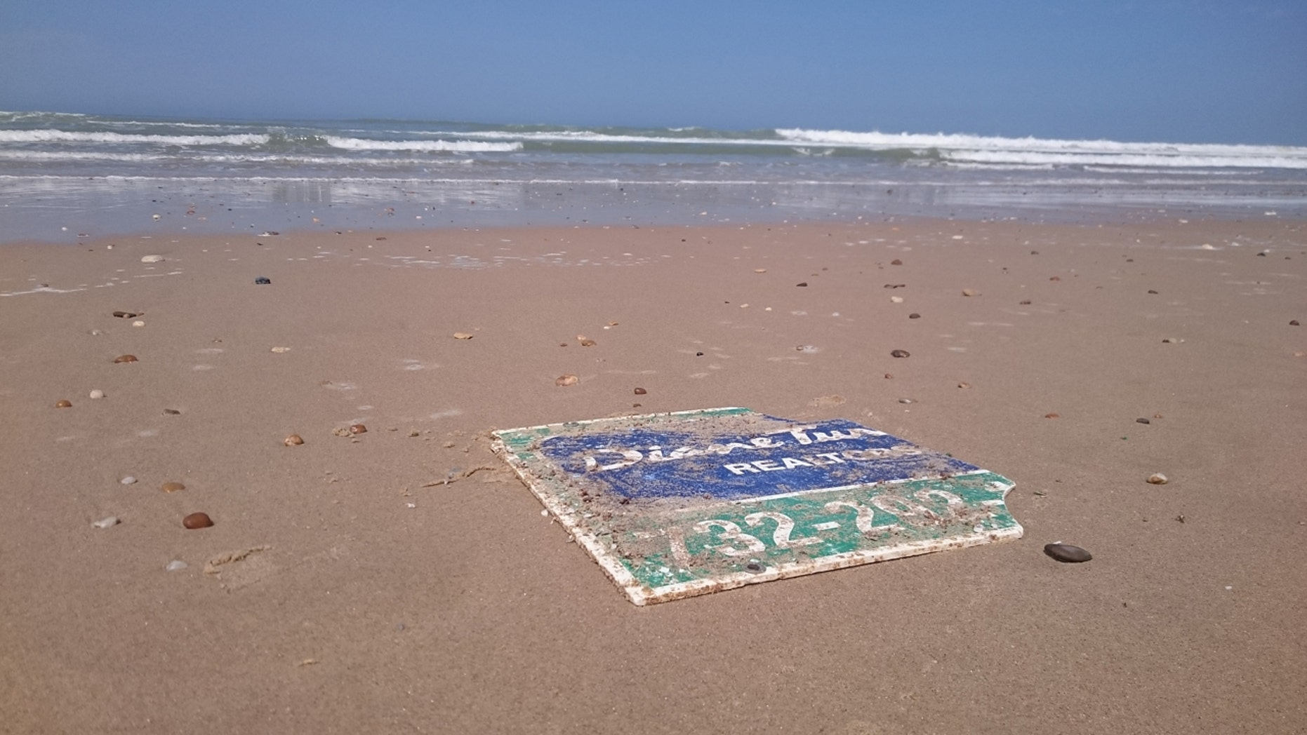 A damaged sign blown away from the Jersey Shore during Hurricane Sandy in 2012. The sign ultimately washed up on a French beach.