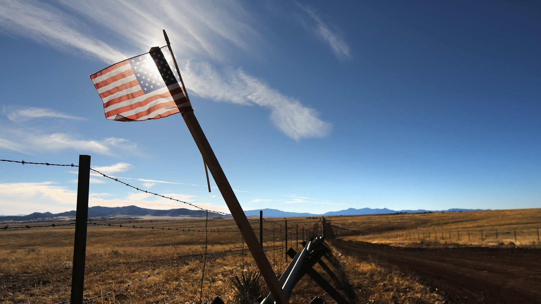 An American flag flies at the U.S.-Mexico border on February 26, 2013 near Sonoita, Arizona.