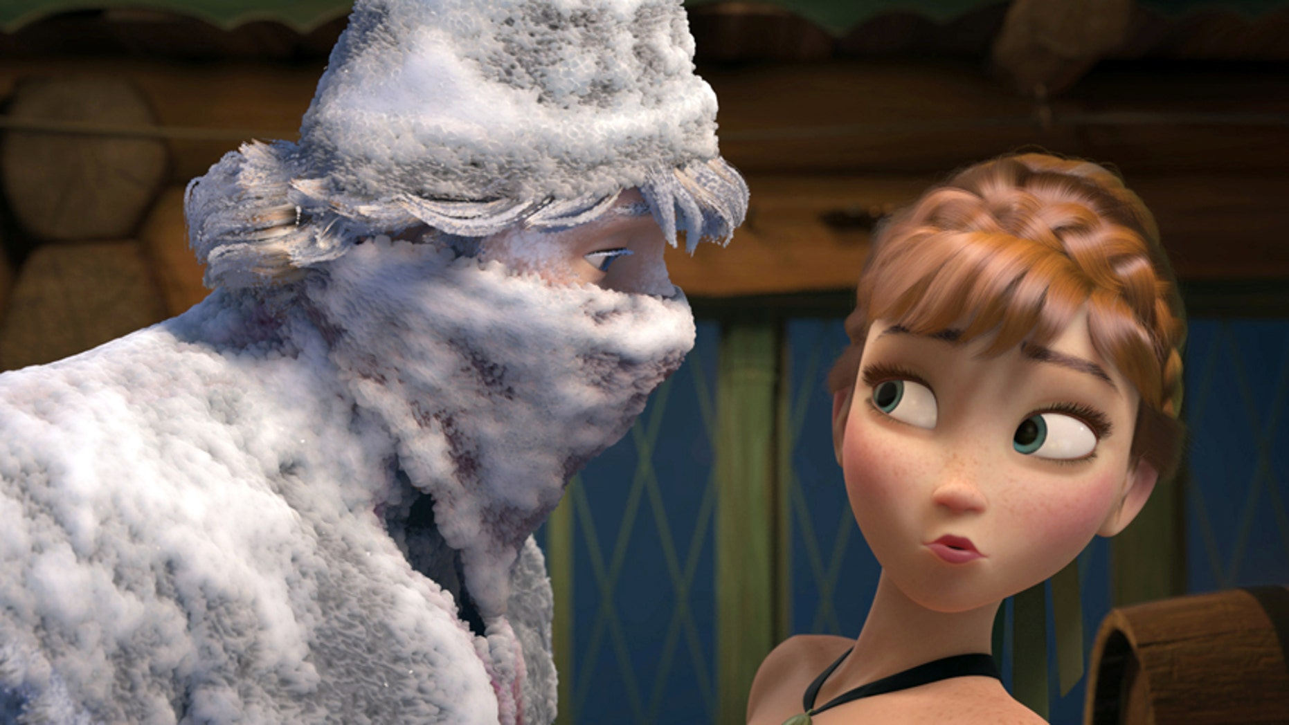 """This image released by Disney shows Kristoff, voiced by Jonathan Groff, left, and Anna, voiced by Kristen Bell, in a scene from the animated feature film, """"Frozen.""""  (AP Photo/Disney)"""