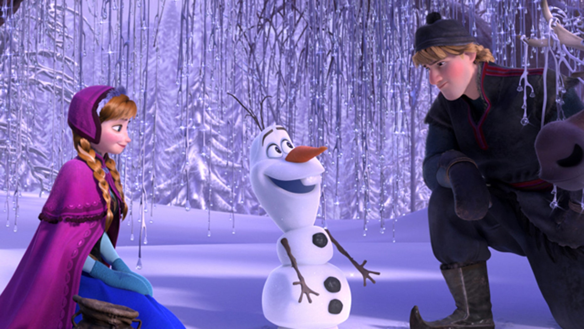 """Anna, voiced by Kristen Bell, Olaf, voiced by Josh Gad, and Kristoff, voiced by Jonathan Groff in a scene from the animated feature """"Frozen."""""""