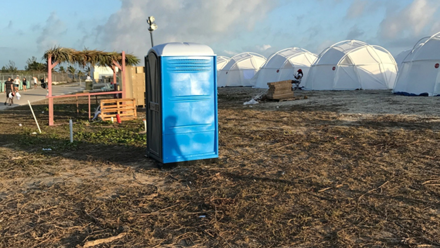 Tents and a portable toilet set up for attendees for the now-cancelled Fyre Festival in the Bahamas.
