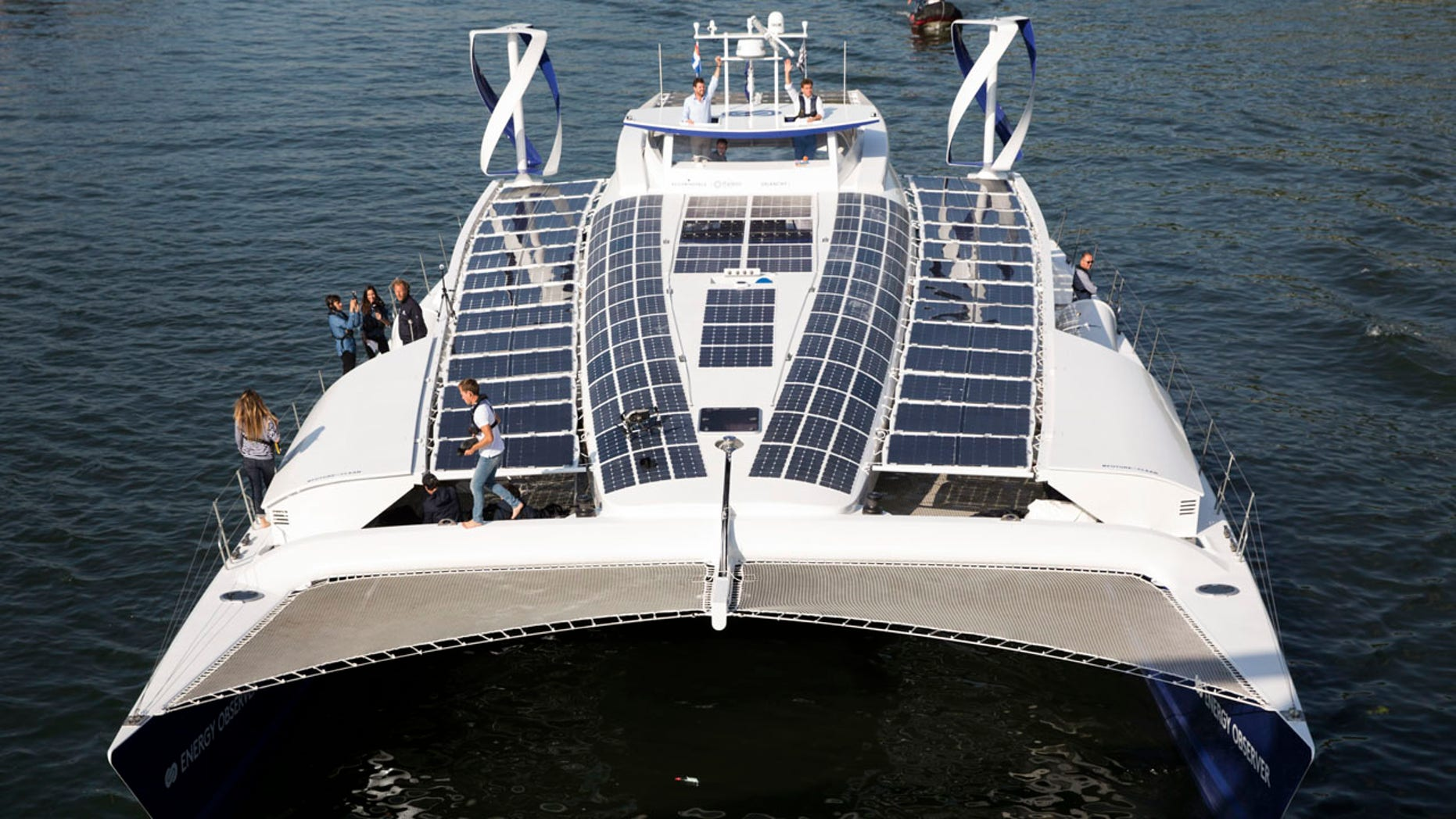 In this Tuesday, July 4, 2017 file photo, the Energy Observer, a former race boat turned into a autonomous navigation with hydrogen, sails on the Seine river in Paris.