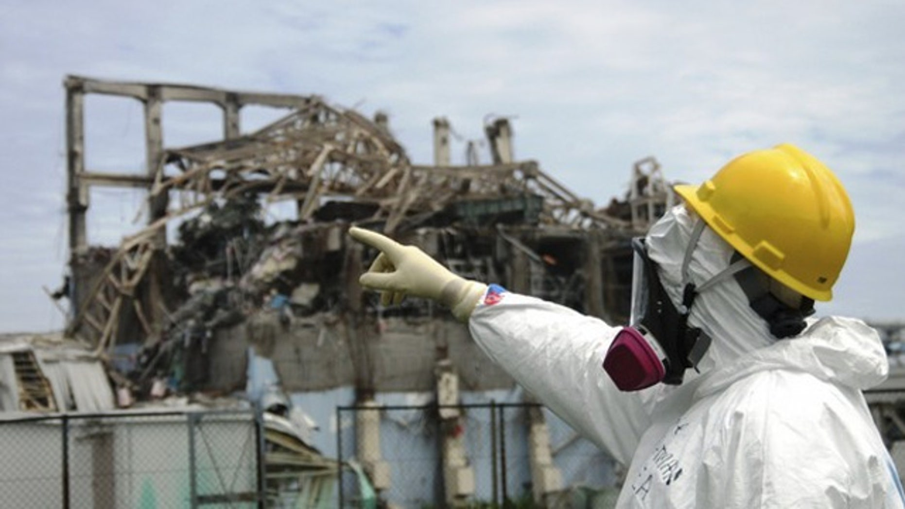 International Atomic Energy Agency (IAEA) fact-finding team leader Mike Weightman examines the No. 3 reactor at the Fukushima Daiichi Nuclear Power Plant. Radioactive sulfur from the disaster reached California, according to researchers.