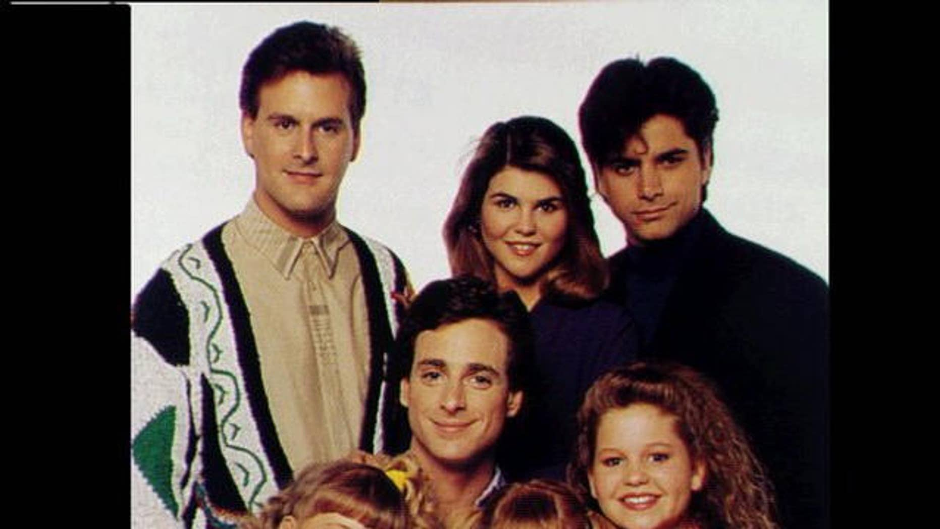 """An undated photo of the """"Full House"""" cast."""