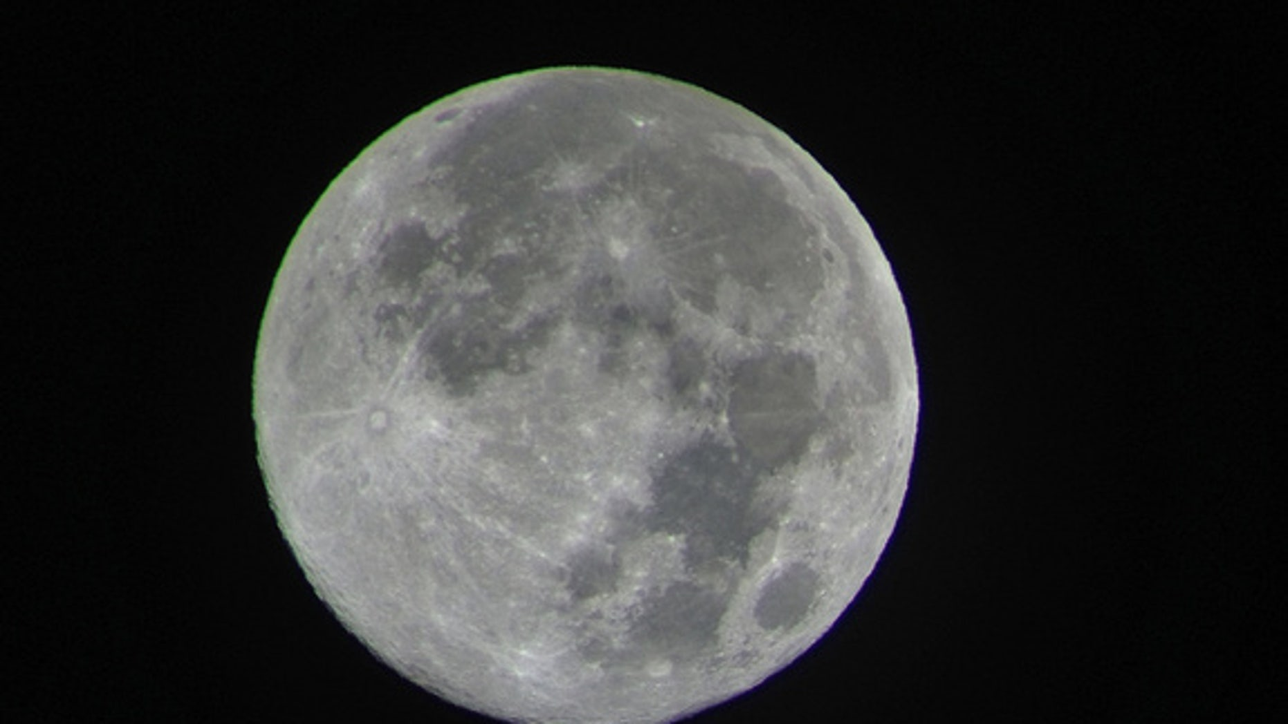"""Night sky watcher Kalani Pokipala sent this image of the full moon from Honolulu, HI, taken August 2, 2012. Pokipala writes: """"All is well and still in Hawaii. Aloha!"""""""