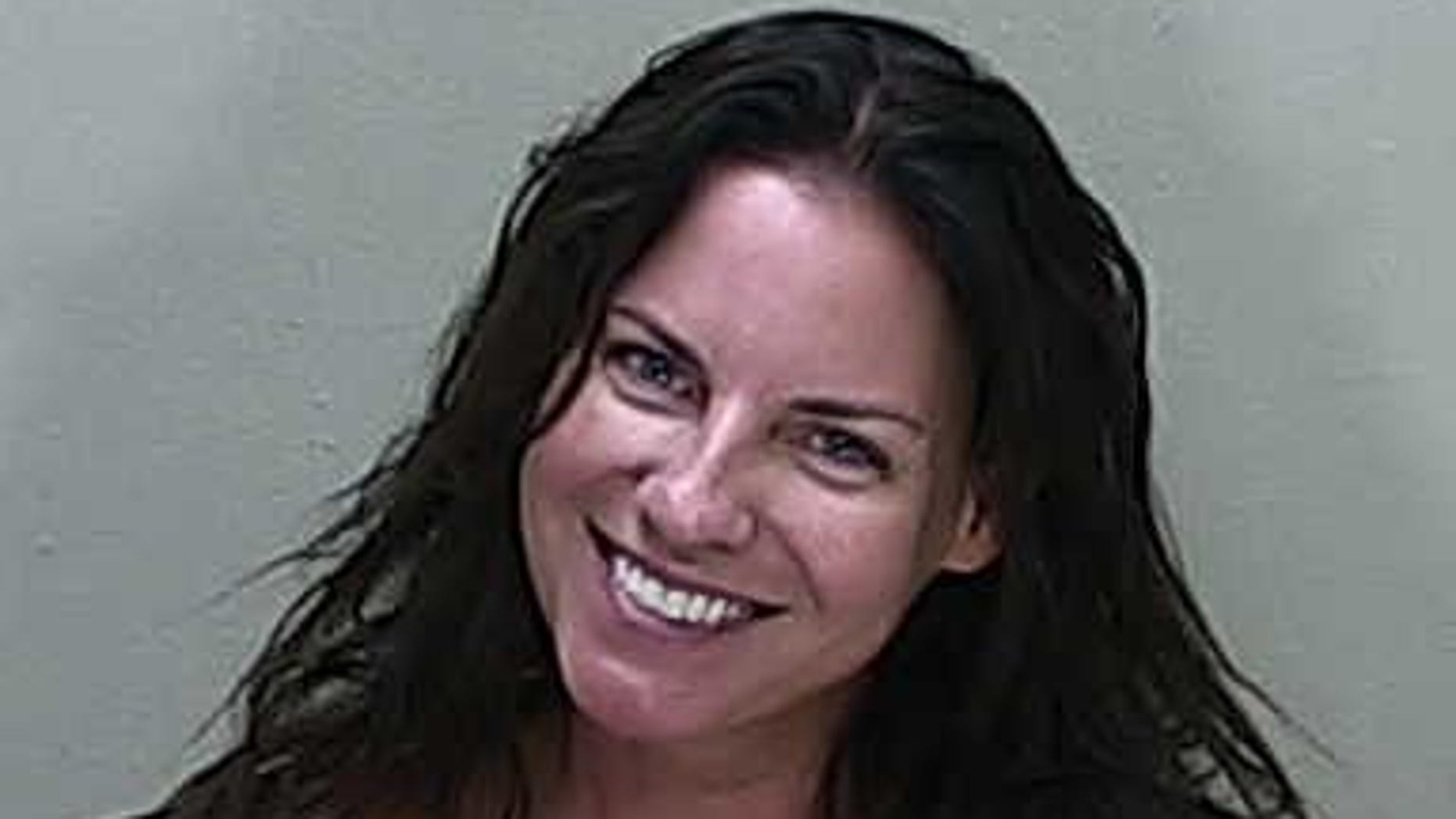 Angenette Welk, 44, smiling in her mugshot following a DUI crash that killed a mother days later, officials say.