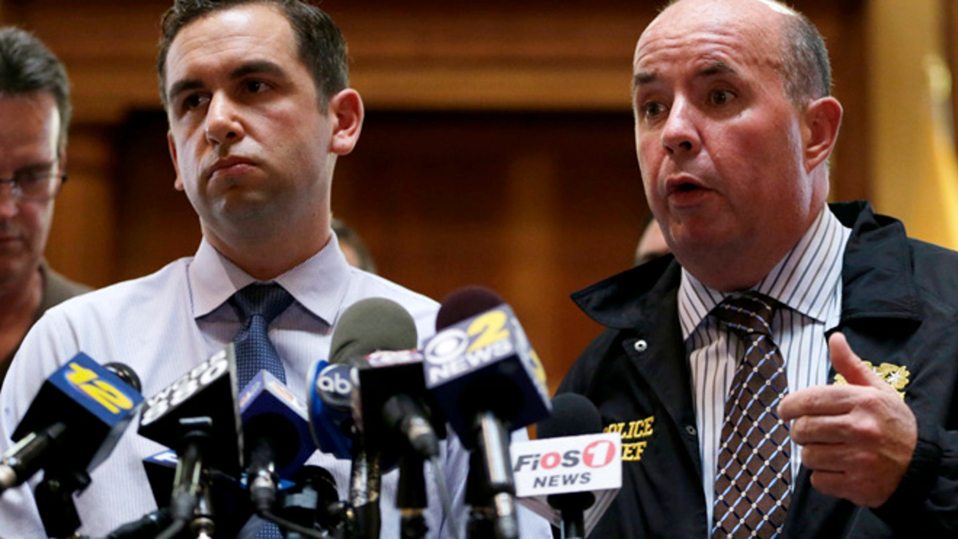 July 13, 2014: Jersey City Police Chief Robert Cowan, right, talks while standing next to Mayor Steven Fulop during a news conference talking about an early morning shooting which lead to the killings of a suspect and a Jersey City Police Department officer.