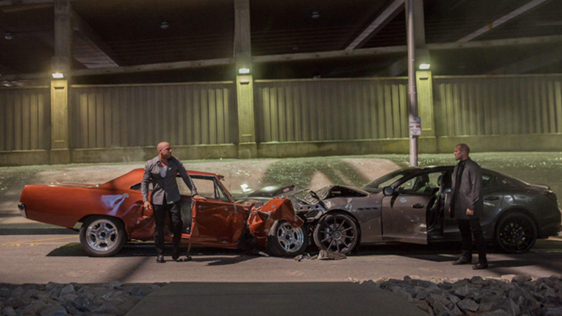 """Vin Diesel, left, as Dom Toretto, and Jason Statham, as Deckard Shaw, in a scene from """"Furious 7."""""""