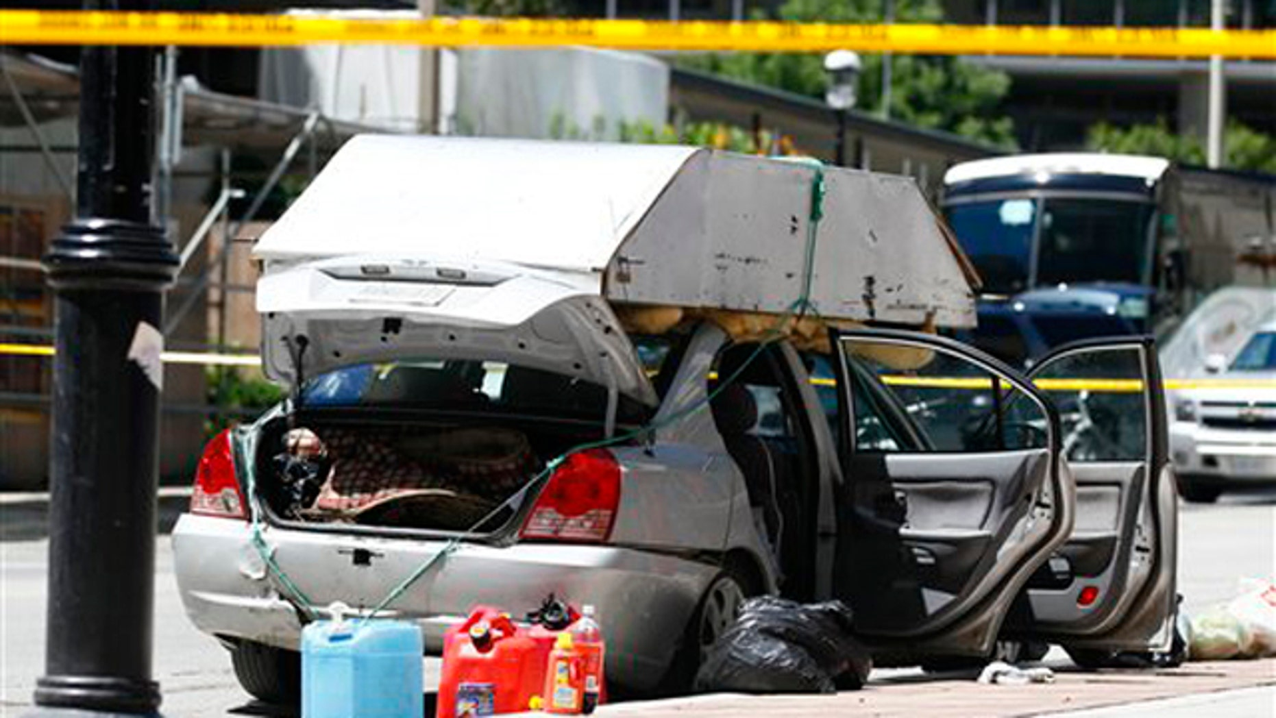 June 24: A car seized by police sits near the intersection of Scott Street and Esplanade in Toronto.