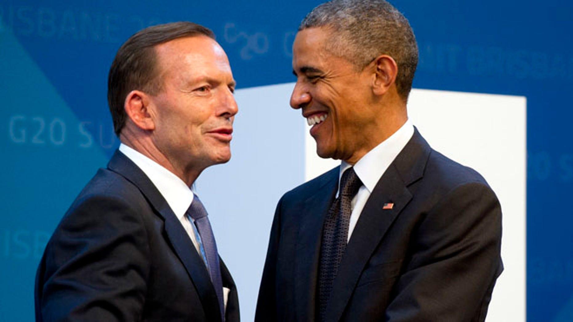 Nov. 15, 2014: U.S. President Barack Obama, right, is welcomed by Australia's Prime Minister Tony Abbott upon arrival for the G20 Summit in Brisbane, Australia. (AP)