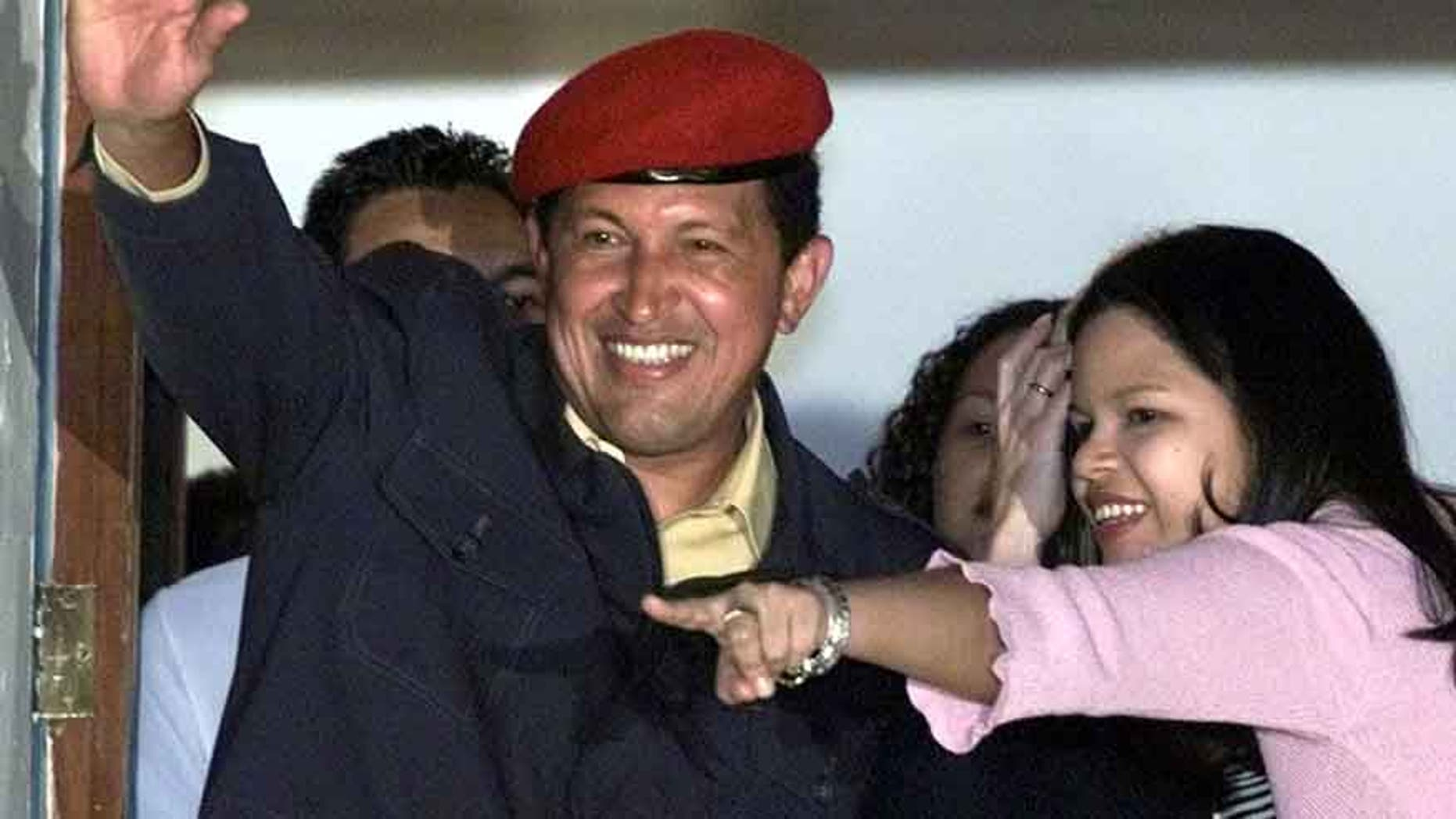 Late President Chavez and his daughter Maria Gabriela in a July 30, 2000 file photo.