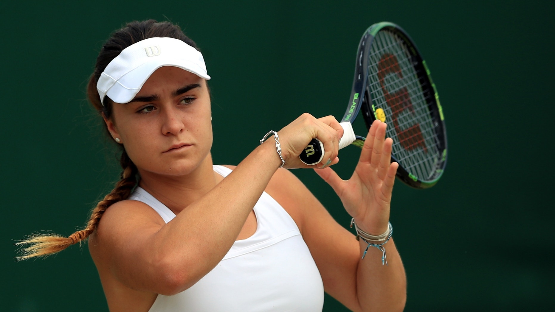 This is a July 2016 file photo of of rising British tennis star Gabriella Taylor in action at Wimbledon London. British police are investigating allegations that Taylor a player at the Wimbledon tennis tournament was poisoned, after she fell ill with a bacterial infection that can be spread through rat urine. Gabriella Taylor was playing in the junior tournament when she became sick.