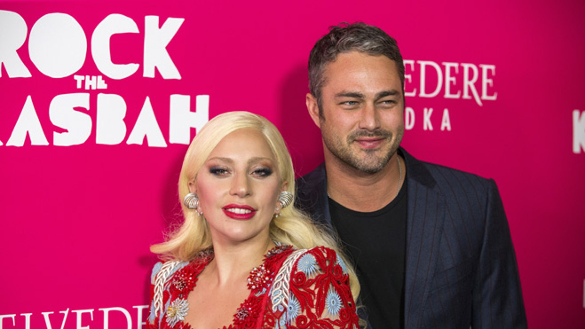 """October 19, 2015. Singer Lady Gaga arrives with Taylor Kinney for the premiere of the film """"Rock the Kasbah"""" in New York."""