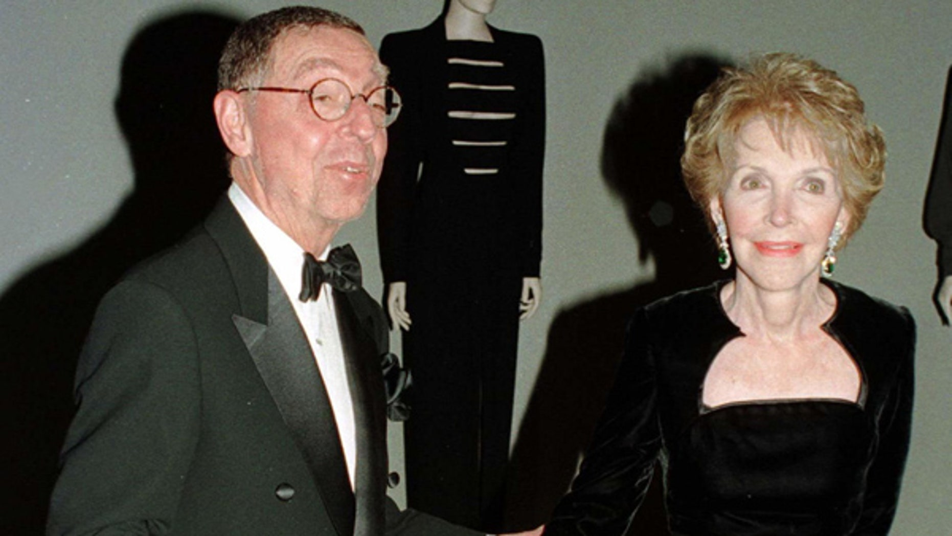 Former first lady Nancy Reagan and fashion designer James Galanos tour an exhibition of fashion designs by Galanos at the Los Angeles County Museum of Art during a reception March 25. Mrs. Reagan wore many Galanos gowns during her years at the the White House.