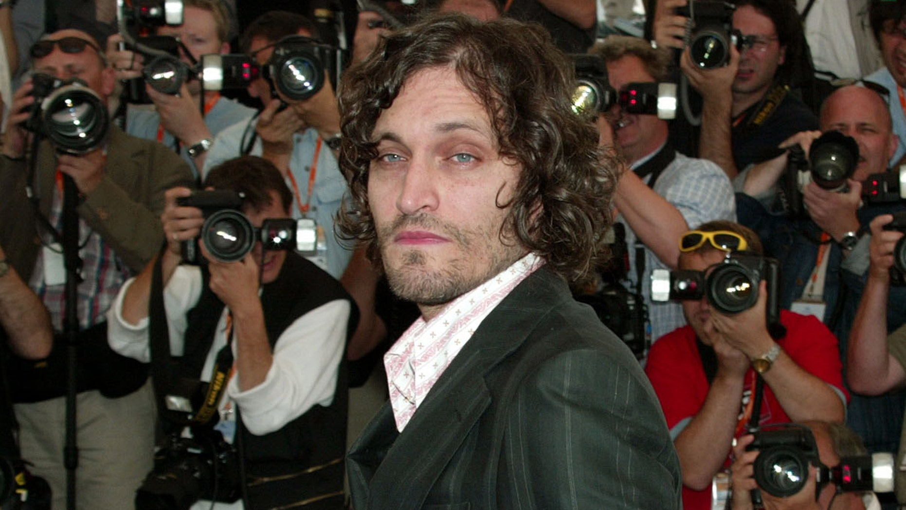 """US director and actor Vincent Gallo poses during a photocall for his film """"The Brown Bunny"""" at the 56th International Film Festival in Cannes, May 21, 2003. Gallo's film entry is one of twenty in competition for the Palme d'Or (Golden Palm) at the 12-day film festival on the French Riviera."""