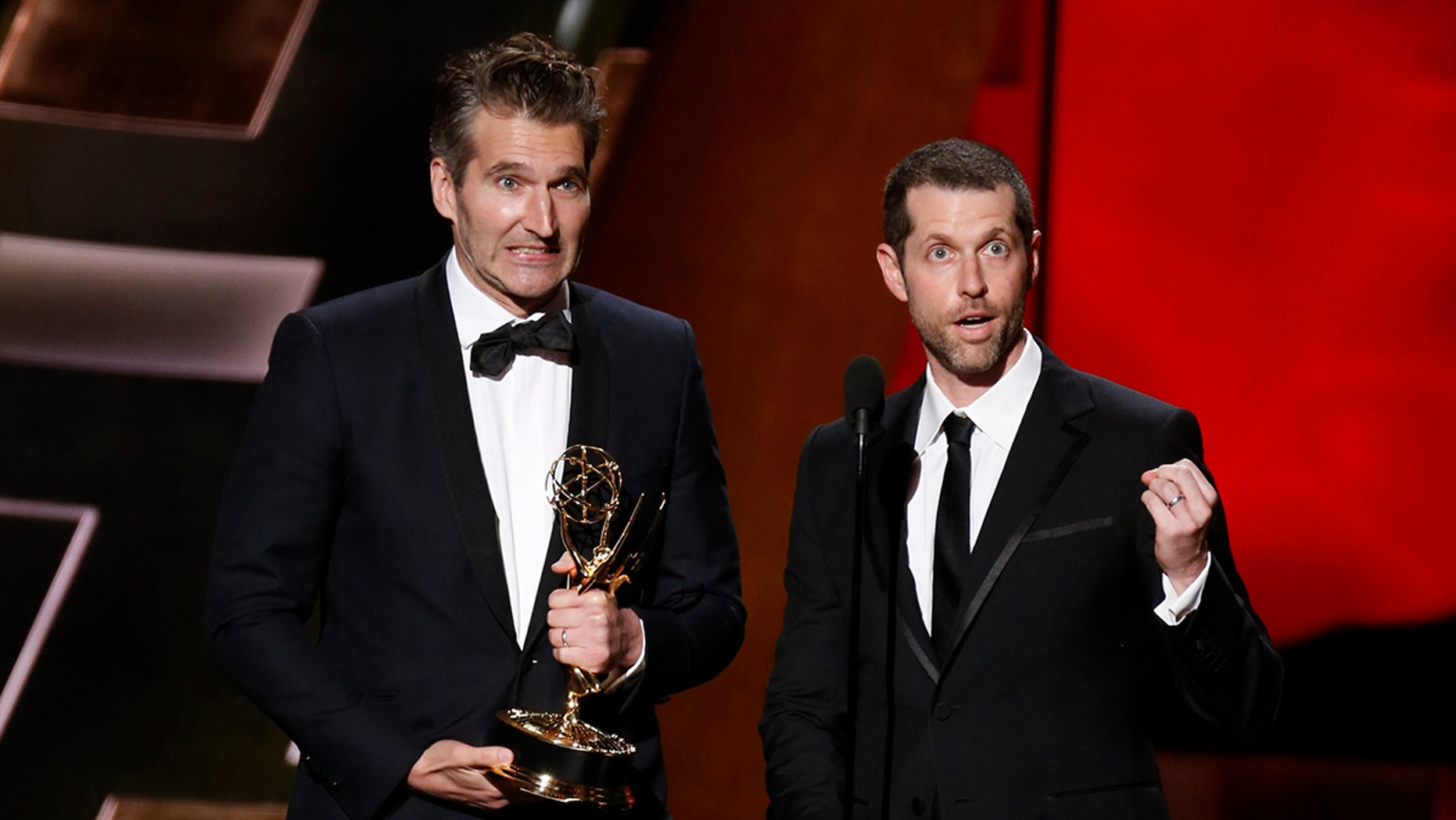 """David Benioff (L) and D.B. Weiss accept the award for Outstanding Writing For A Drama Series for HBO's """"Game of Thrones"""" at the 67th Primetime Emmy Awards in Los Angeles, California September 20, 2015.  REUTERS/Lucy Nicholson - TB3EB9L06GQU7"""