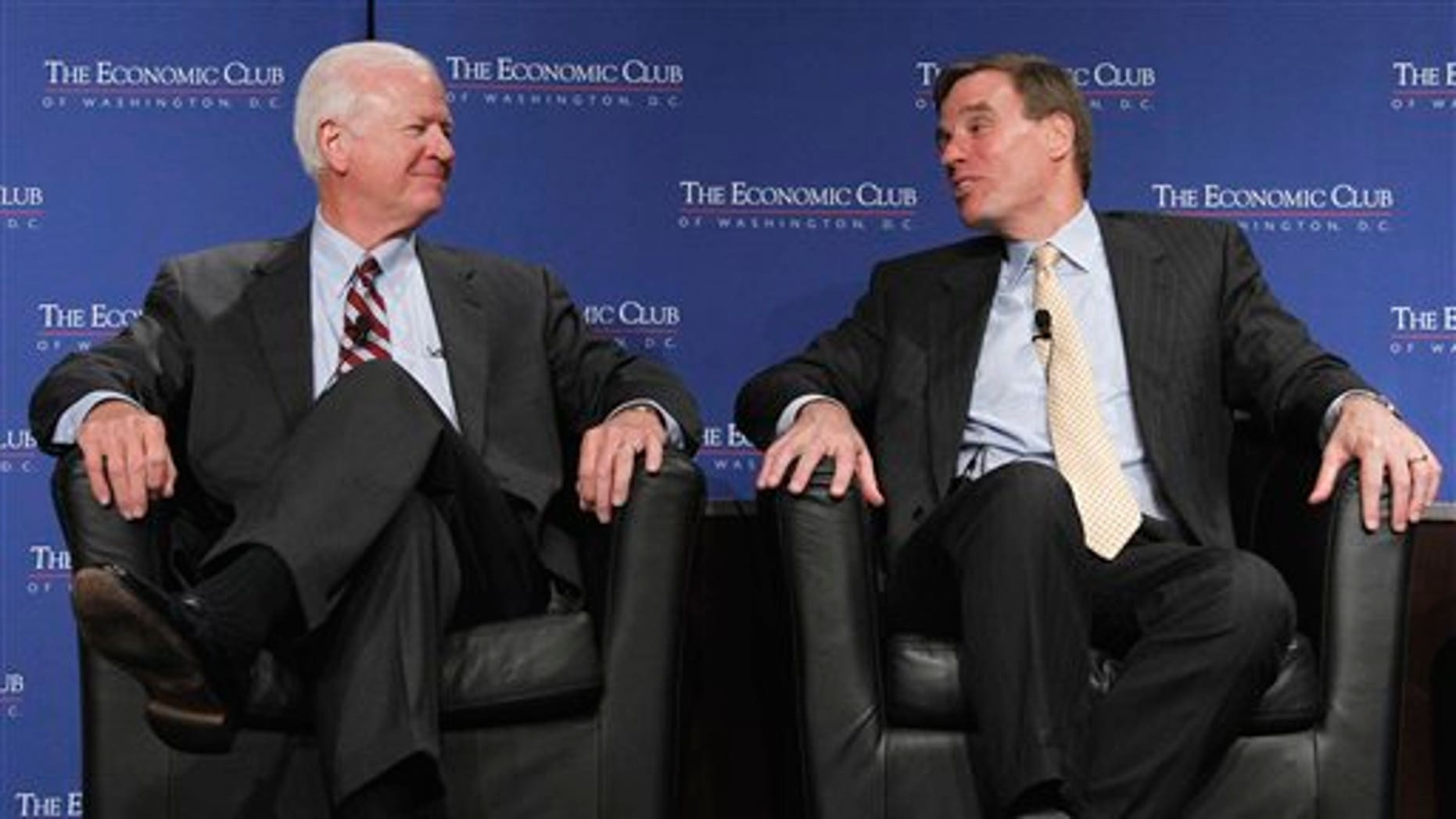 """June 8: Sen. Saxby Chambliss, R-Ga. and Sen. Mark Warner, D-Va., members of """"The Gang of Six"""" participate in a discussion on the federal budget, deficit reduction and the debt ceiling during a luncheon of the Economic Club in Washington, D.C."""