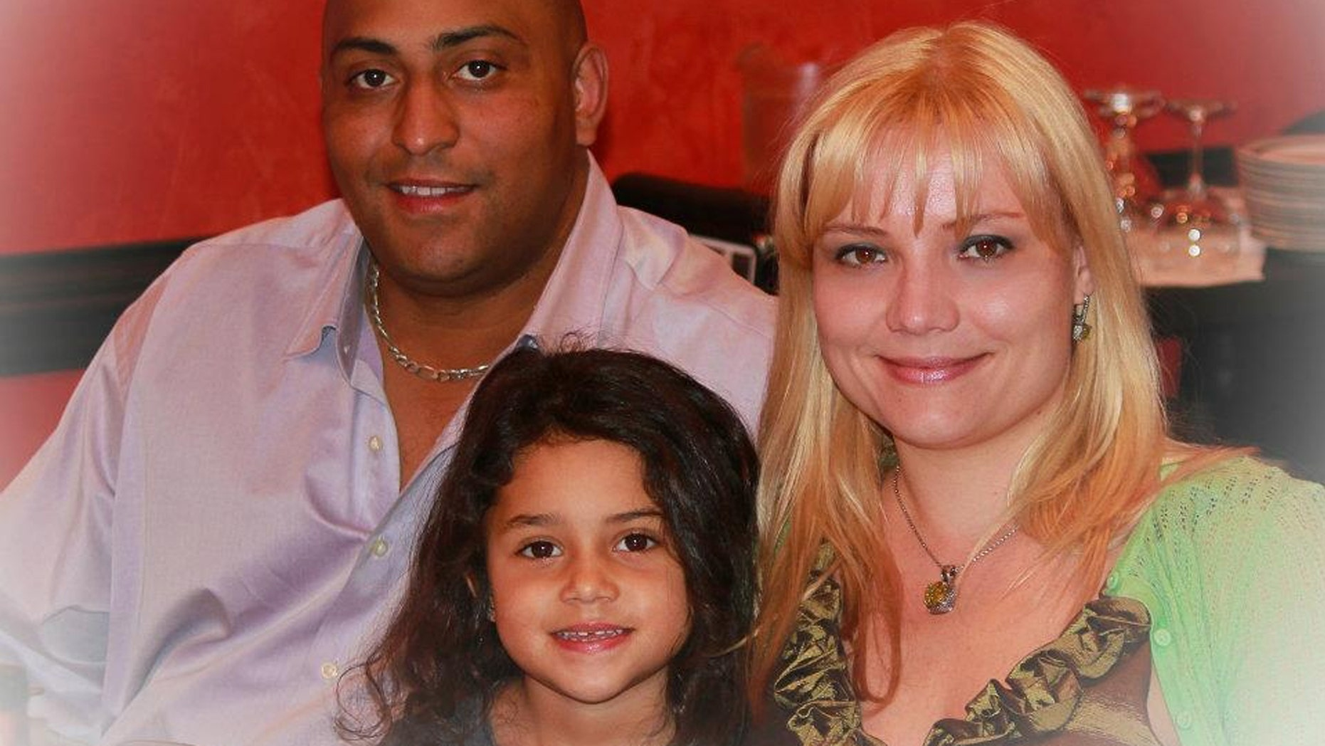 Hamlet Garcia, 42, his wife, Olesia Garica, 34, and their seven year old daughter Fiorella.