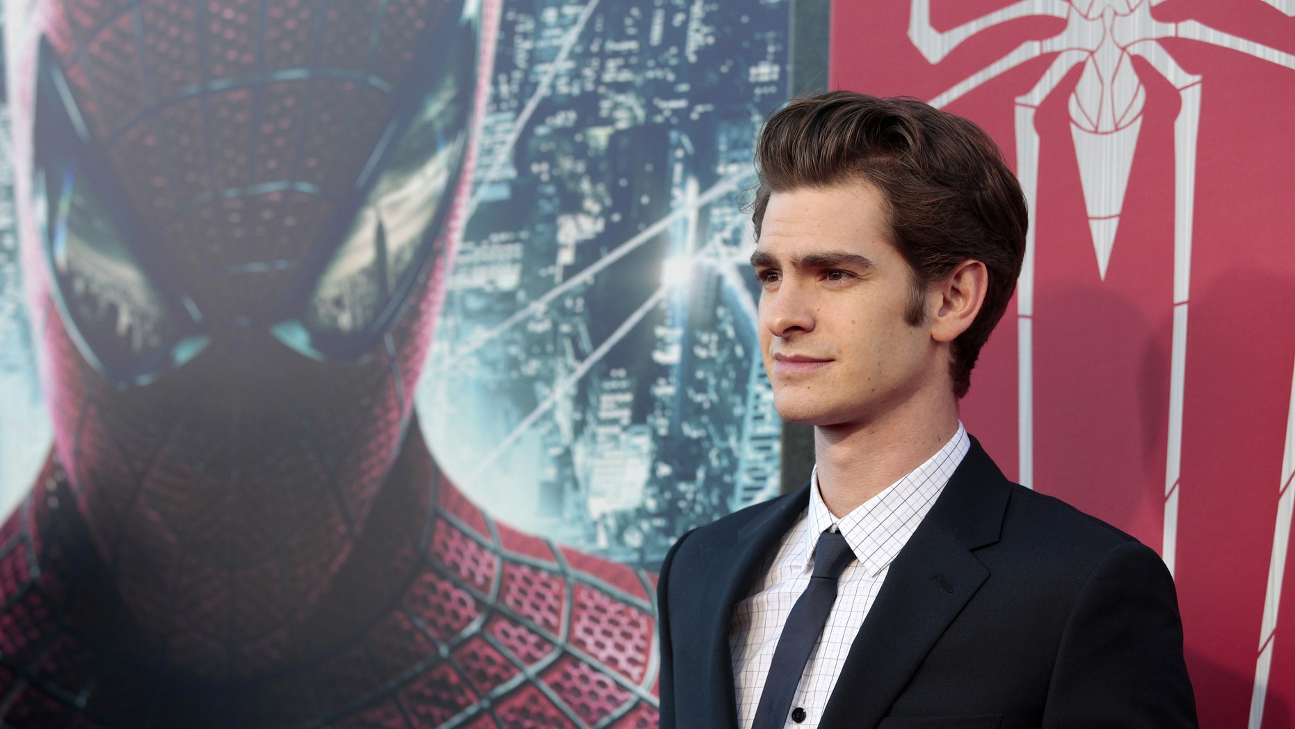 """July 3, 2012. Andrew Garfield poses at the premiere of """"The Amazing Spider-Man"""" at the Regency Village theatre in Los Angeles, California."""