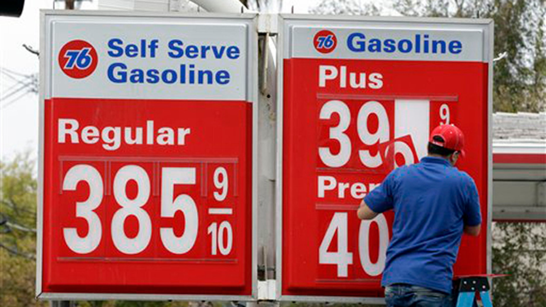 Nov. 11, 2011: A worker changes the gas prices at his Union 76 gas station in Oakland, Calif.