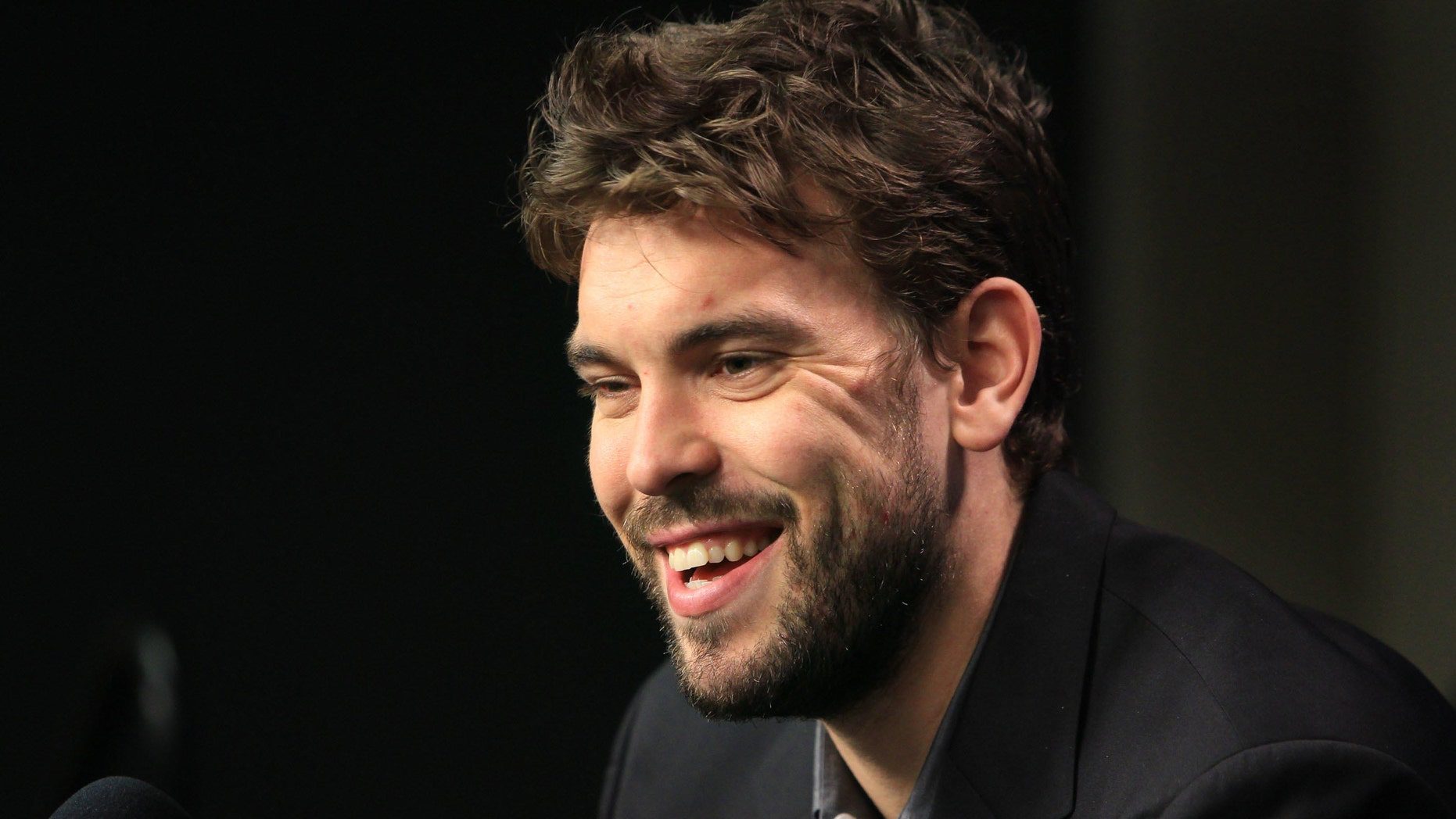 Memphis Grizzlies' Marc Gasol smiles during a press conference announcing his re-signing with the NBA basketball team, Wednesday, Dec. 14, 2011, in Memphis, Tenn. The deal keeps intact the core of a team that made the Western Conference semifinals last spring. (AP Photo/The Commercial Appeal, Nikki Boertman)