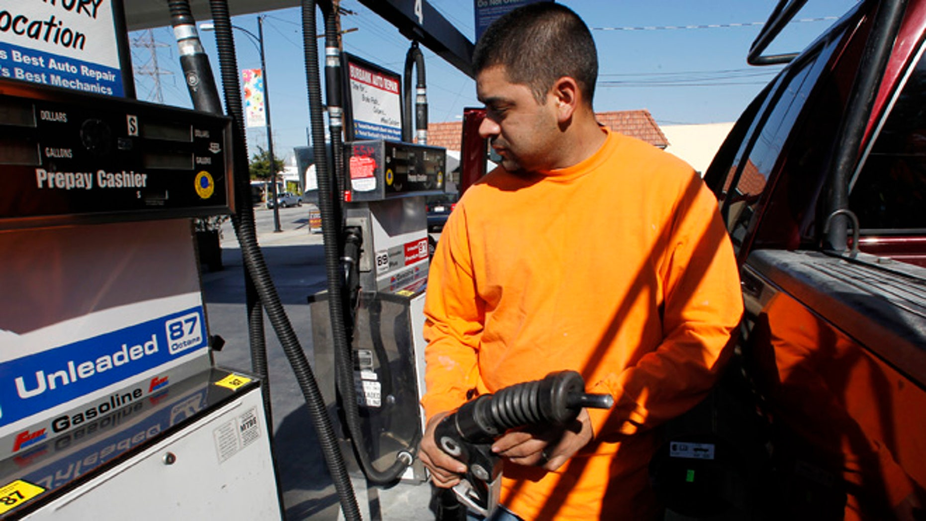 FILE 2011: A driver refills at a California gas station.