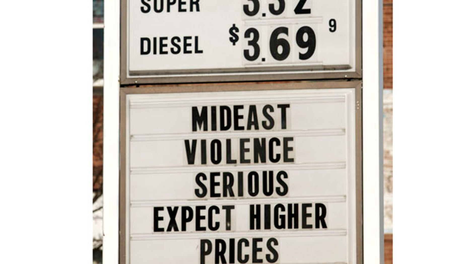 Feb. 23: A sign advertises gas and diesel prices while also giving an explanation to customers at a service station in Easthampton, Mass.