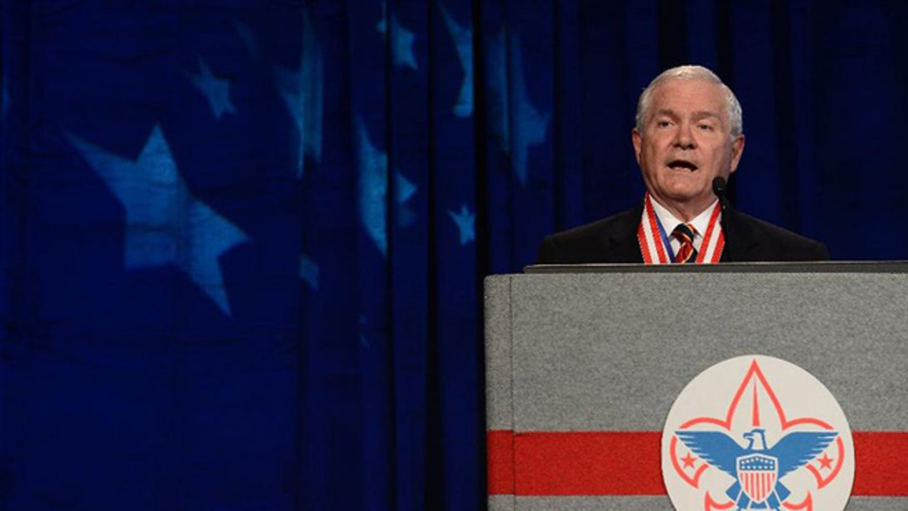 In this Friday, May 23, 2014 file photo, former Defense Secretary Robert Gates addresses the Boy Scouts of America's annual meeting in Nashville, Tenn., after being selected as the organization's new president.