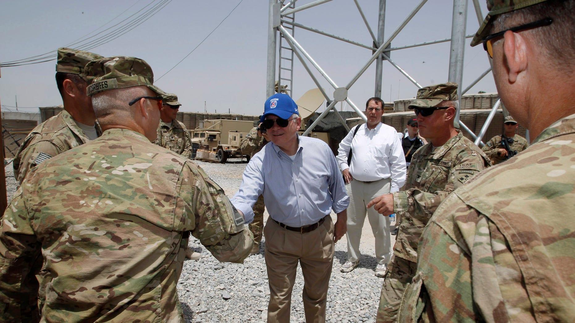 Sunday: Defense Secretary Robert Gates thanks troops at Forward Operating Base (FOB) Walton in Kandahar, Afghanistan.