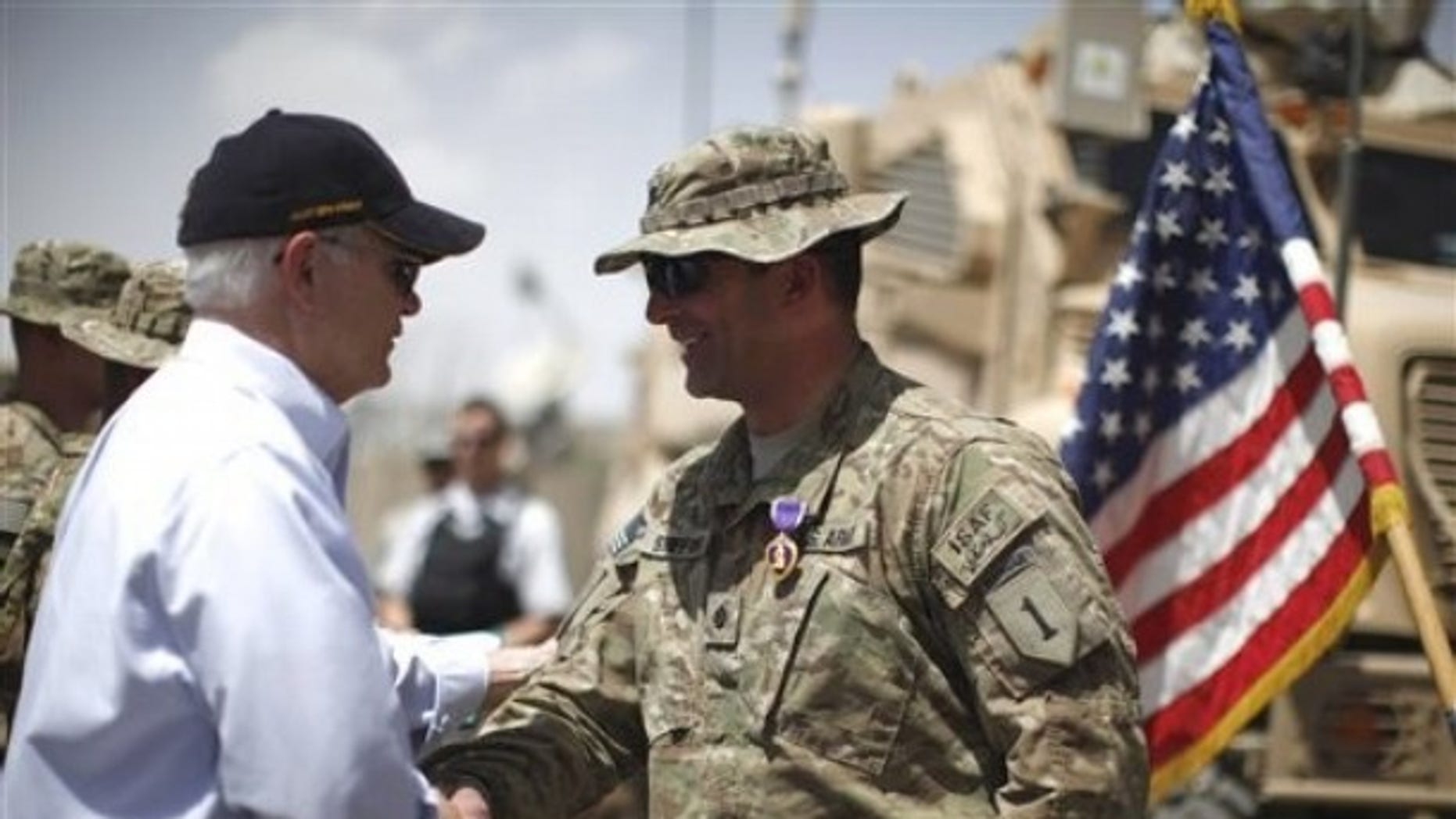 June 6: Defense Secretary Robert Gates shakes hands with U.S. Army LtCol. Alan Streeter after awarding him the Purple Heart Medal for wounds he received in combat during a ceremony at Combat Outpost Andar in Ghazni Province, Afghanistan.