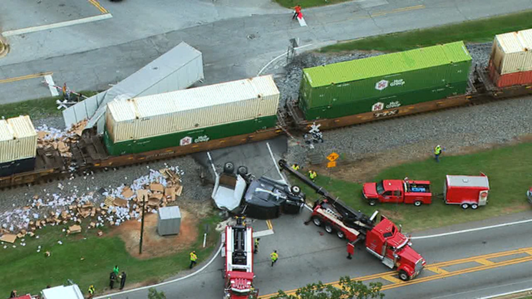 Emergency personnel respond to the site of a collision involving a train and a semi-truck in Henry County, Ga. Thursday.